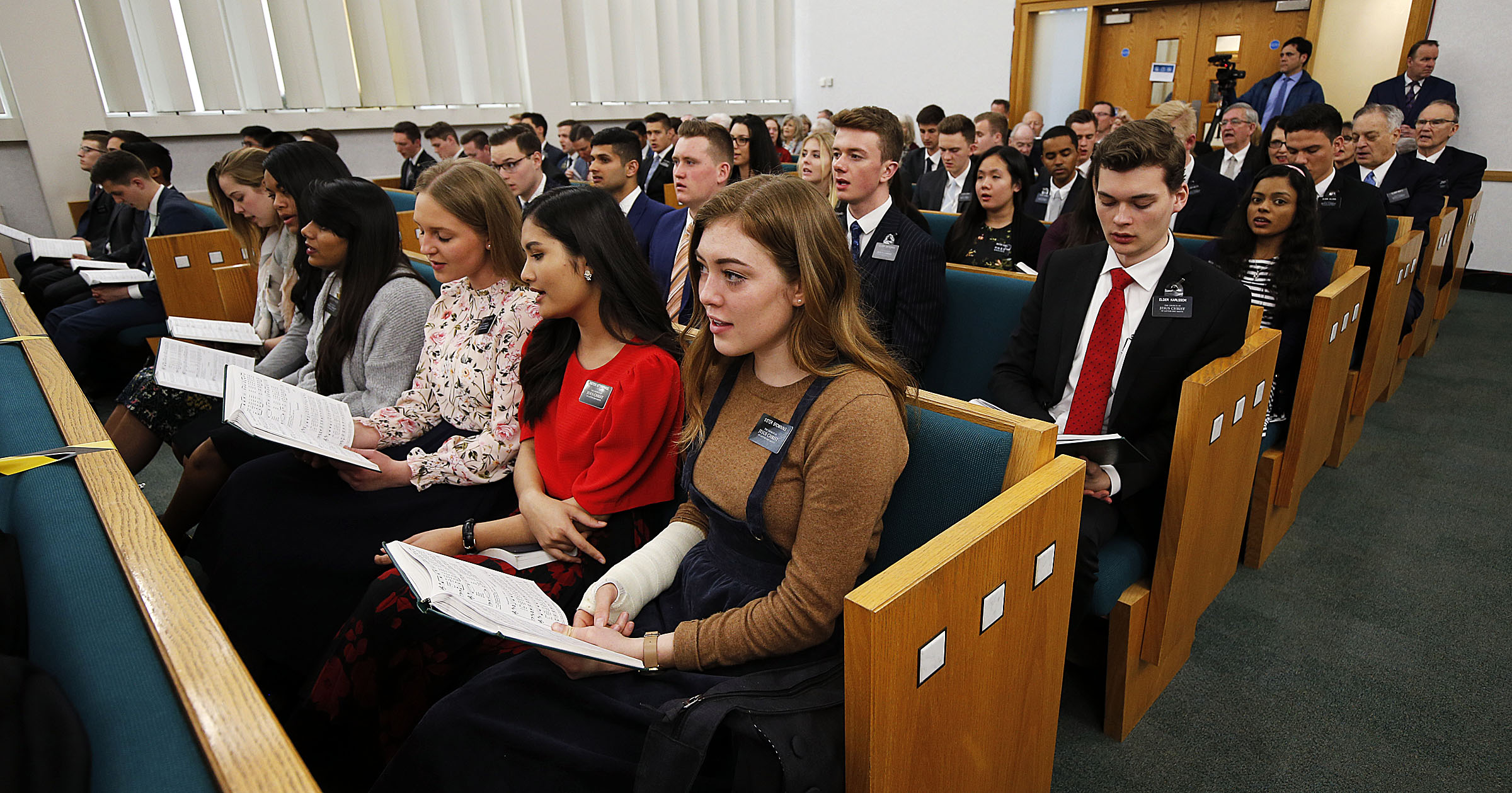 Missionaries sing during a meeting with President Russell M. Nelson and Elder Jeffrey R. Holland at the Hyde Park Chapel in London on Thursday, April 12, 2018.