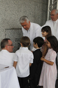 President Dieter F. Uchtdorf, second counselor in the First Presidency, participates in the cornerstone ceremony of the Manaus Brazil Temple Sunday, June 10. From left, Tom Coburn of the Church's Temple Department, Gabruel De Lucena Diniz, 6, Lucas Glavao, 6, Livia Lima, 7, and Giovanna Galvao, 10. Elder William Walker of the Seventy is in background.