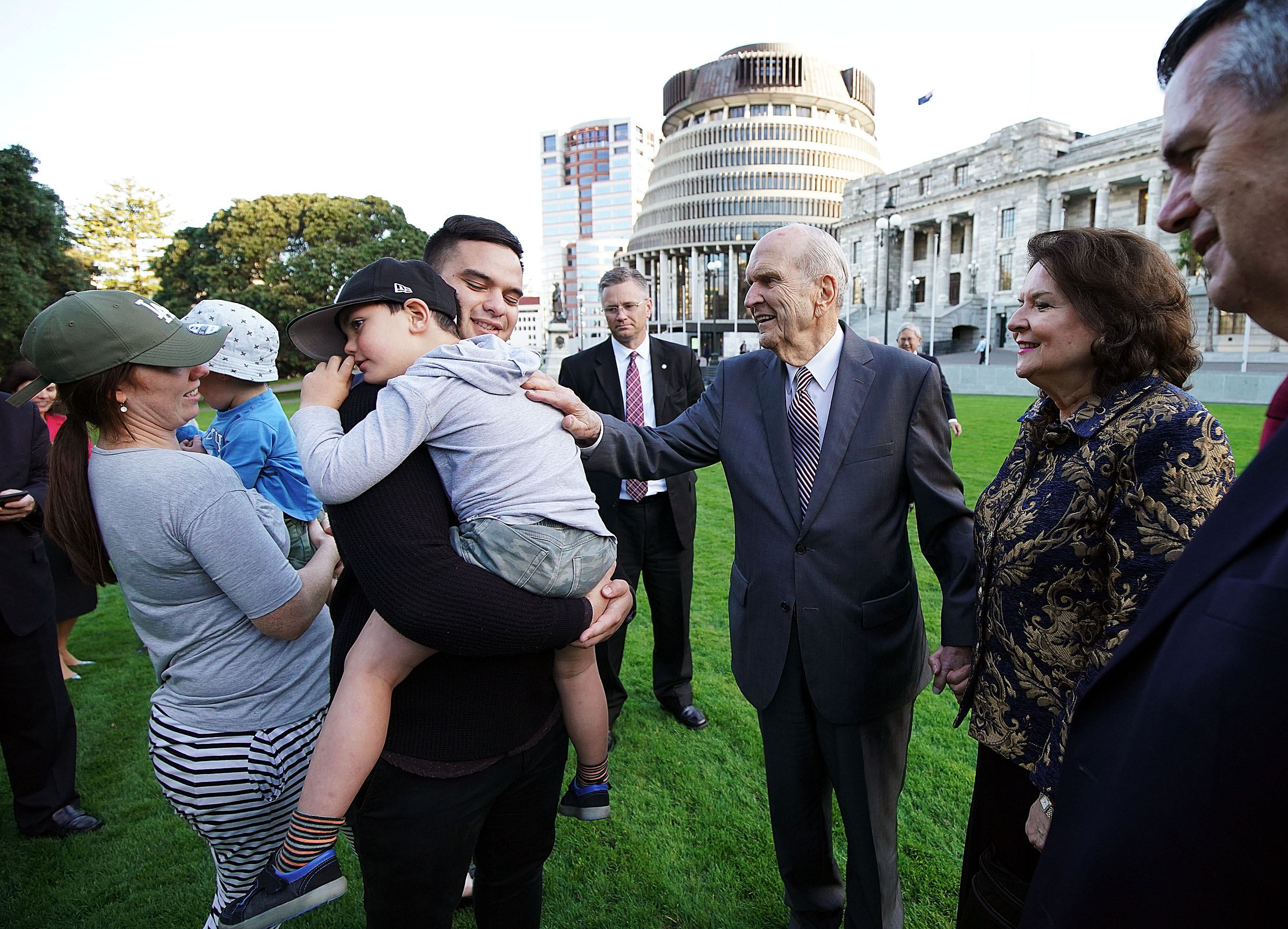 President Russell M. Nelson of The Church of Jesus Christ of Latter-day Saints and his wife, Sister Wendy Nelson, greet Quentin Daniels, holding his son Archer, with Quentin's wife, Rebecca, at left holding their son Gideon, in Wellington, New Zealand, on Monday, May 20, 2019.