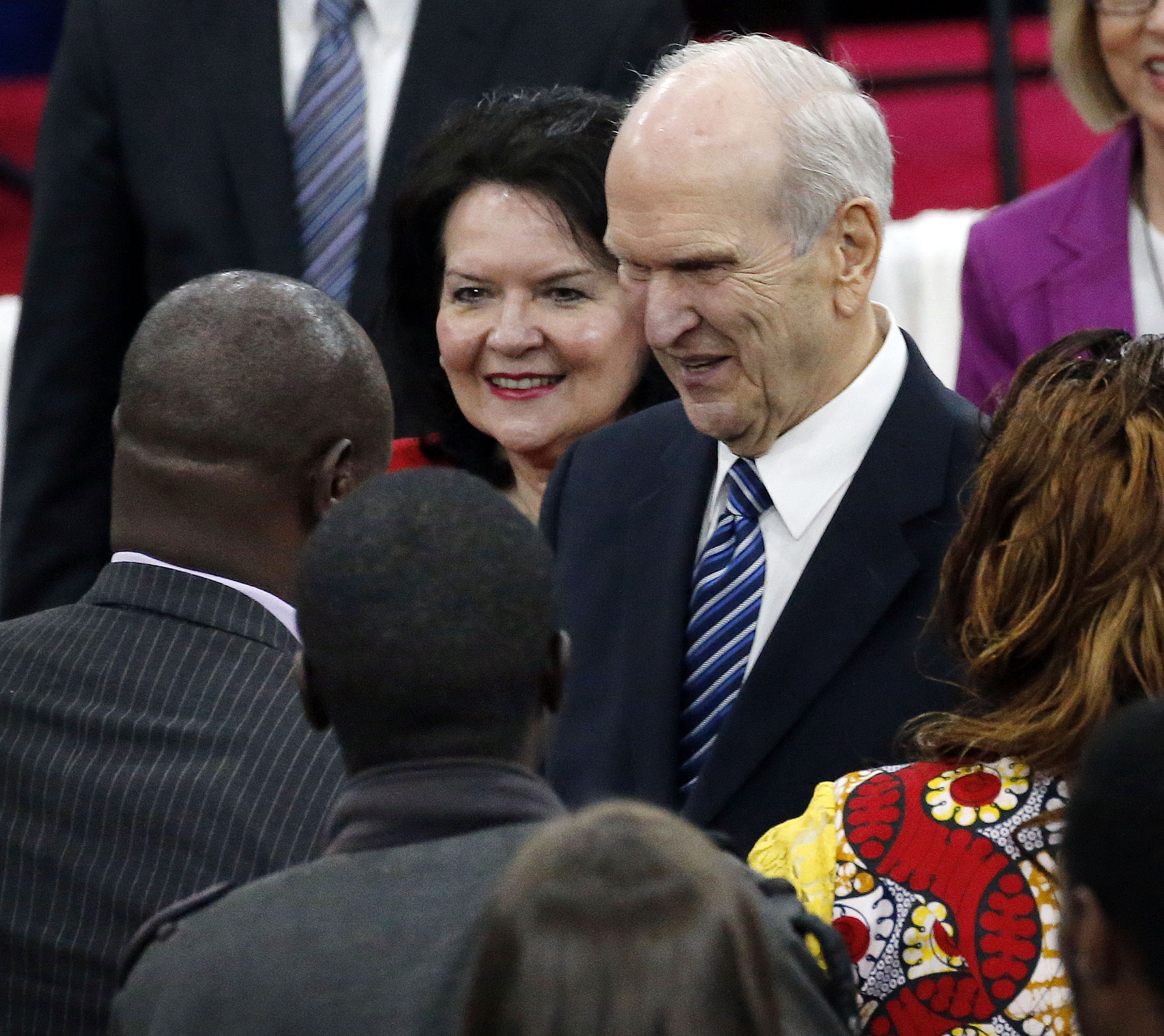 President Russell M. Nelson and Sister Wendy Watson Nelson of The Church of Jesus Christ of Latter-day Saints greet some of those in attendance following a special devotional in Nairobi, Kenya, on Monday, April 16, 2018.