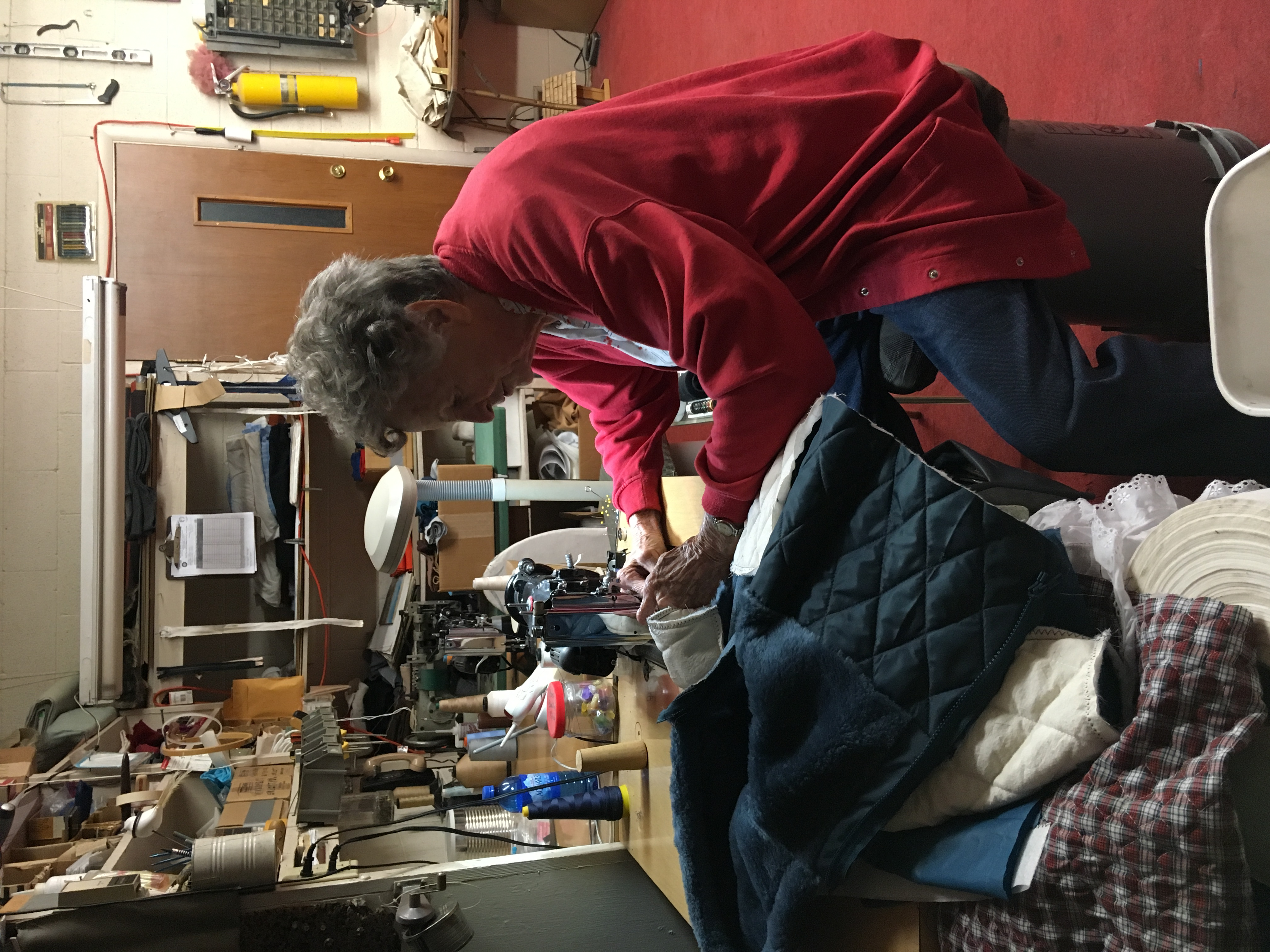 Betty Luke photographed sewing one of her handmade winter coats.