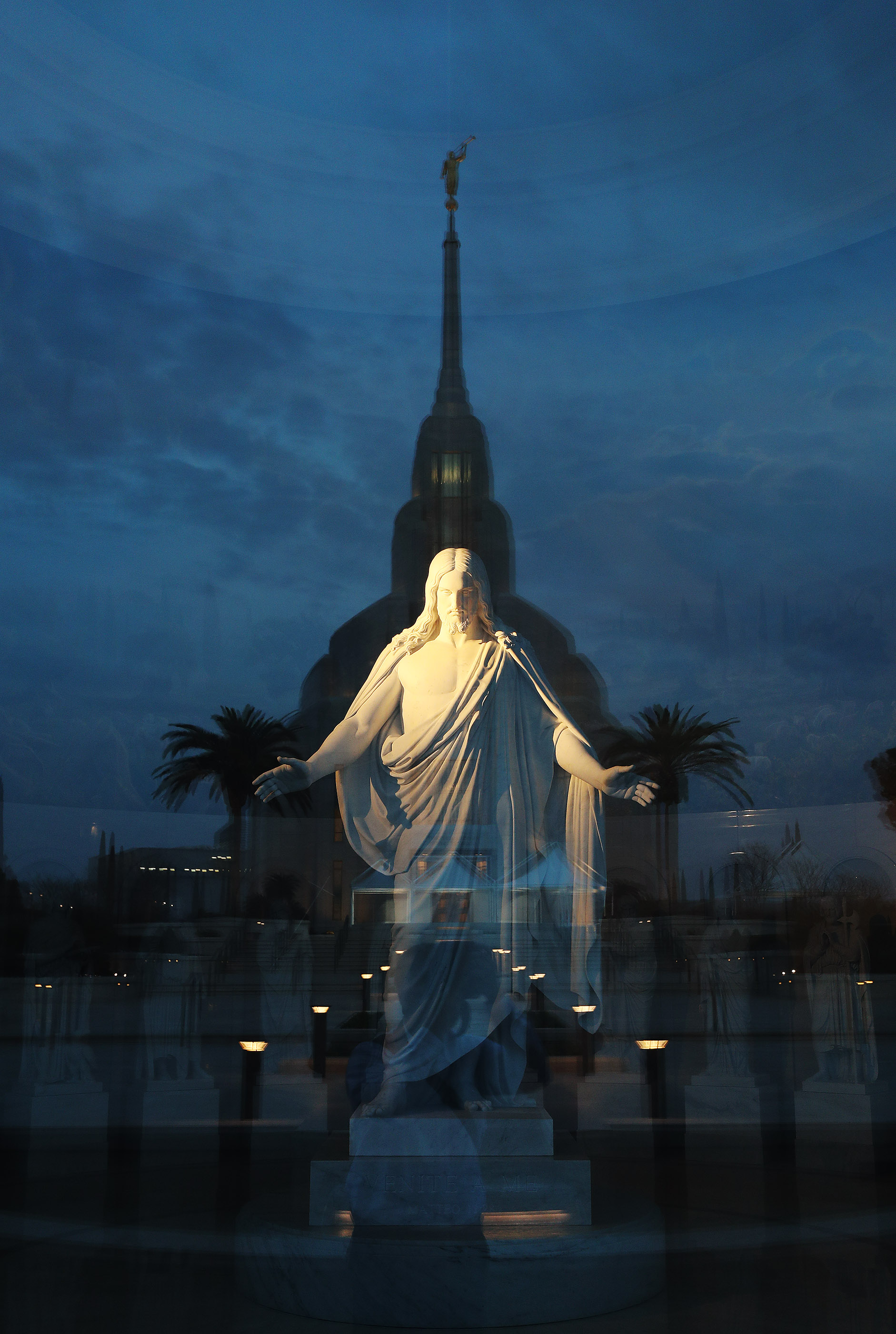 The Christus is illuminated in the Rome Italy Temple Visitors' center with a reflection of the temple in Rome, Italy, on Friday, March 8, 2019.