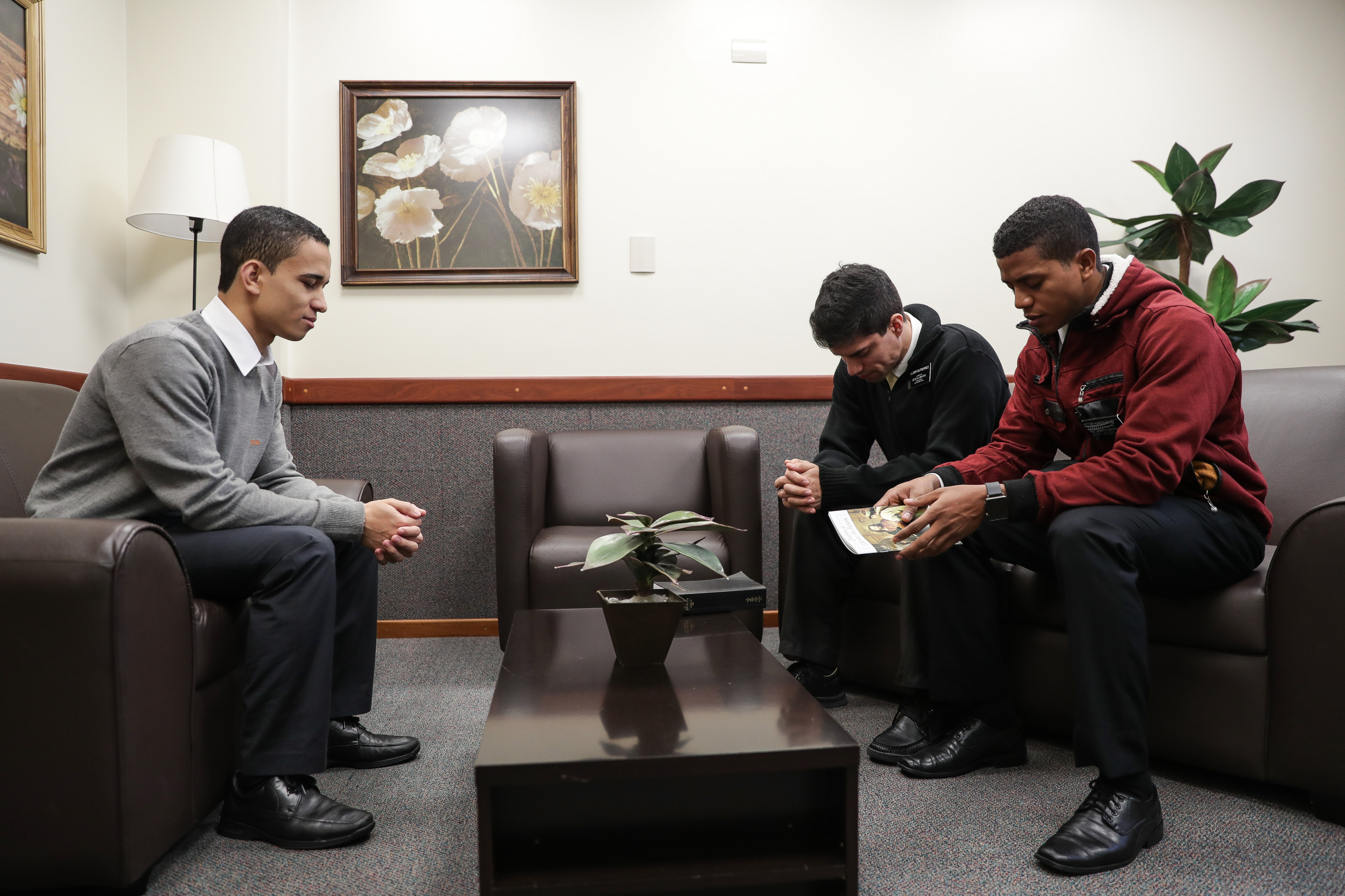 Brother Farias, an MTC instructor, left, prays with Elder Abraham Gutierrez and Elder Erick Puche while the missionaries role-play a home visit at the Brazil Missionary Training Center in São Paulo on Thursday, May 24, 2018.