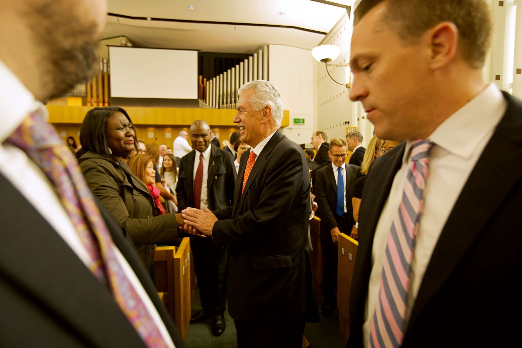 Elder Dieter F. Uchtdorf of the Quorum of the Twelve Apostles greets members following a leadership conference held Sept. 8, 2018, in London, England.