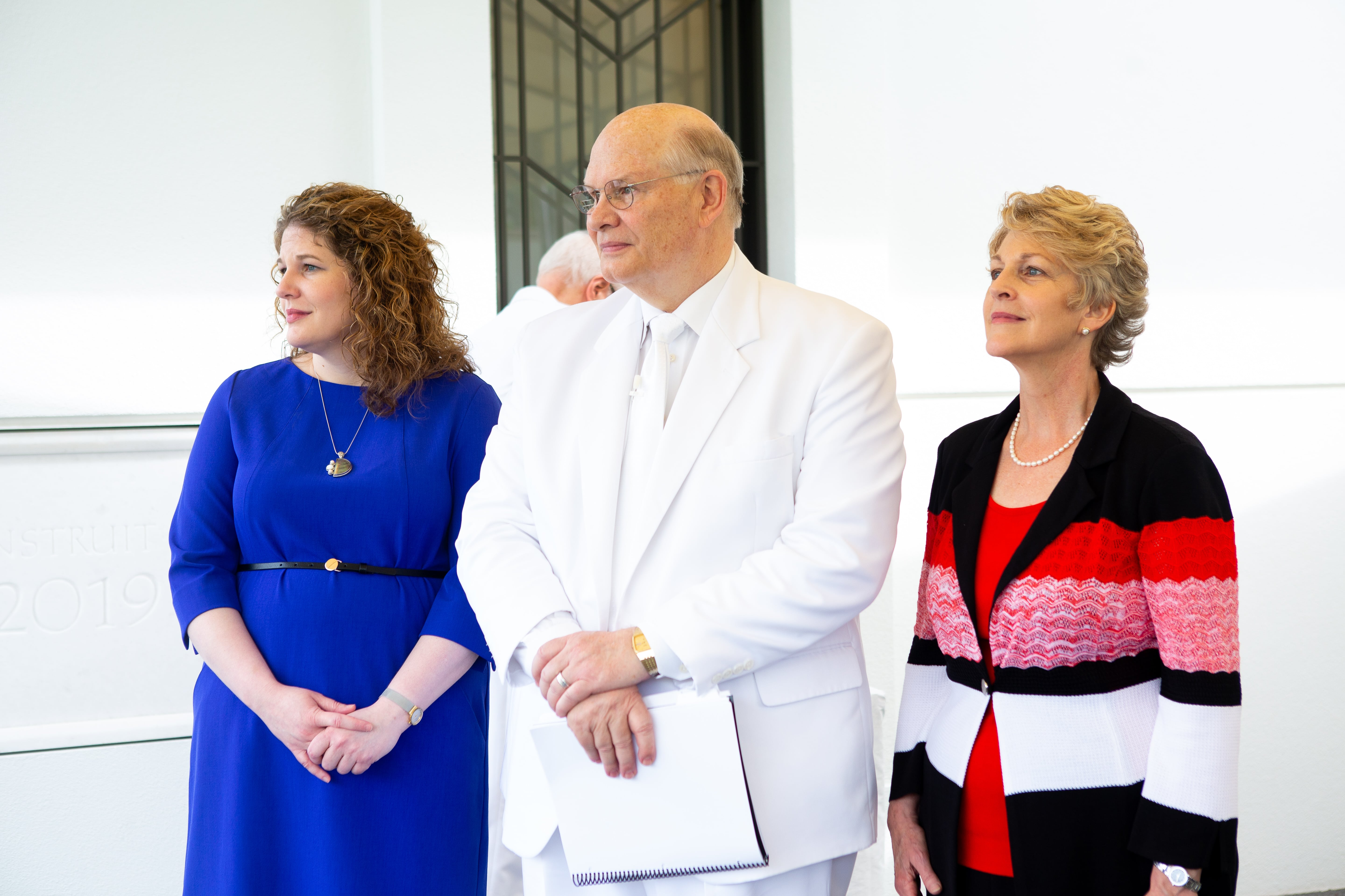 Elder Dale G. Renlund of the Quorum of the Twelve Apostles, center, is joined by his wife, Sister Ruth L. Renlund, right, and their daughter, Ashley Renlund, as he conducts the cornerstone ceremony during the dedication of the Kinshasa Democratic Republic of the Congo Temple on Sunday, April 14, 2019.