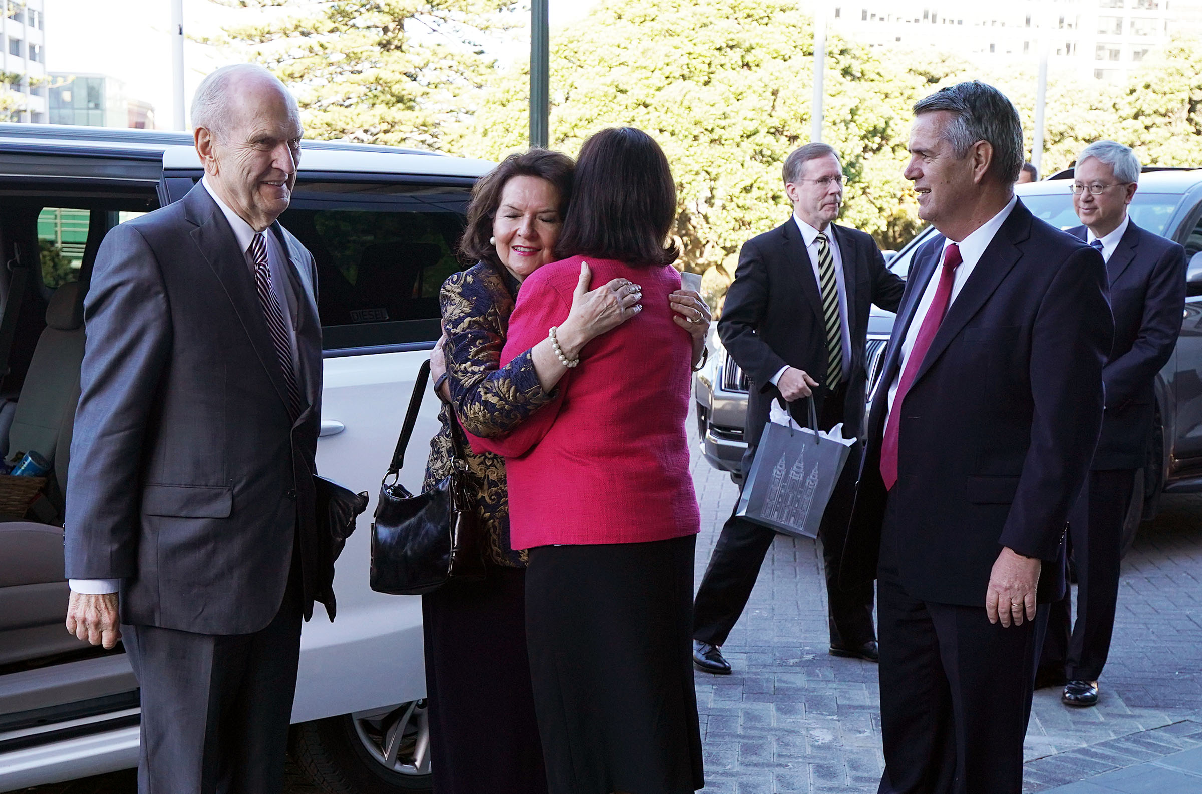 President Russell M. Nelson of The Church of Jesus Christ of Latter-day Saints and his wife, Sister Wendy Nelson, are greeted by Elder Ian S. Ardern, General Authority Seventy and member of the Pacific Area presidency, and his wife, Sister Paula Ardern, as they arrive to meet with New Zealand Prime Minister Jacinta Ardern — Elder Ardern's niece — in Wellington on Monday, May 20, 2019.