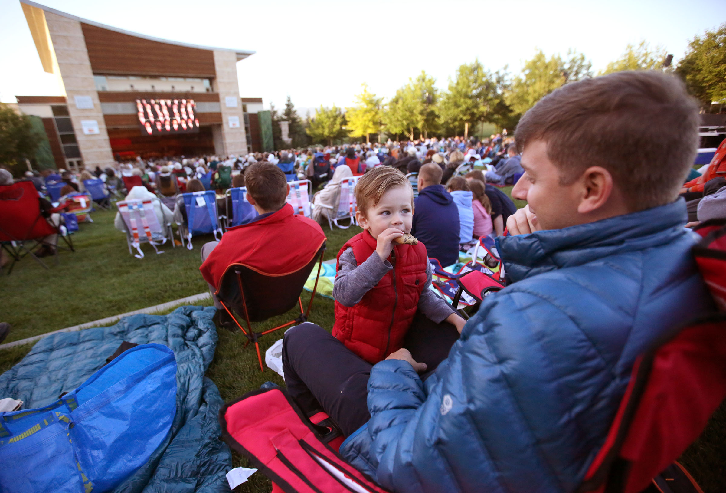 Neil Gruwell eats a cookie with his father Paul Gruwell while listening to the Mormon Tabernacle Choir and Orchestra at Temple Square concert at the Green Music Center in Rohnert Park, California, on Wednesday, June 27, 2018. On Monday, April 27, the Choir and Orchestra announced their 2020 Heritage Tour scheduled for several European nations will be postponed until 2021 due to the COVID-19 pandemic.