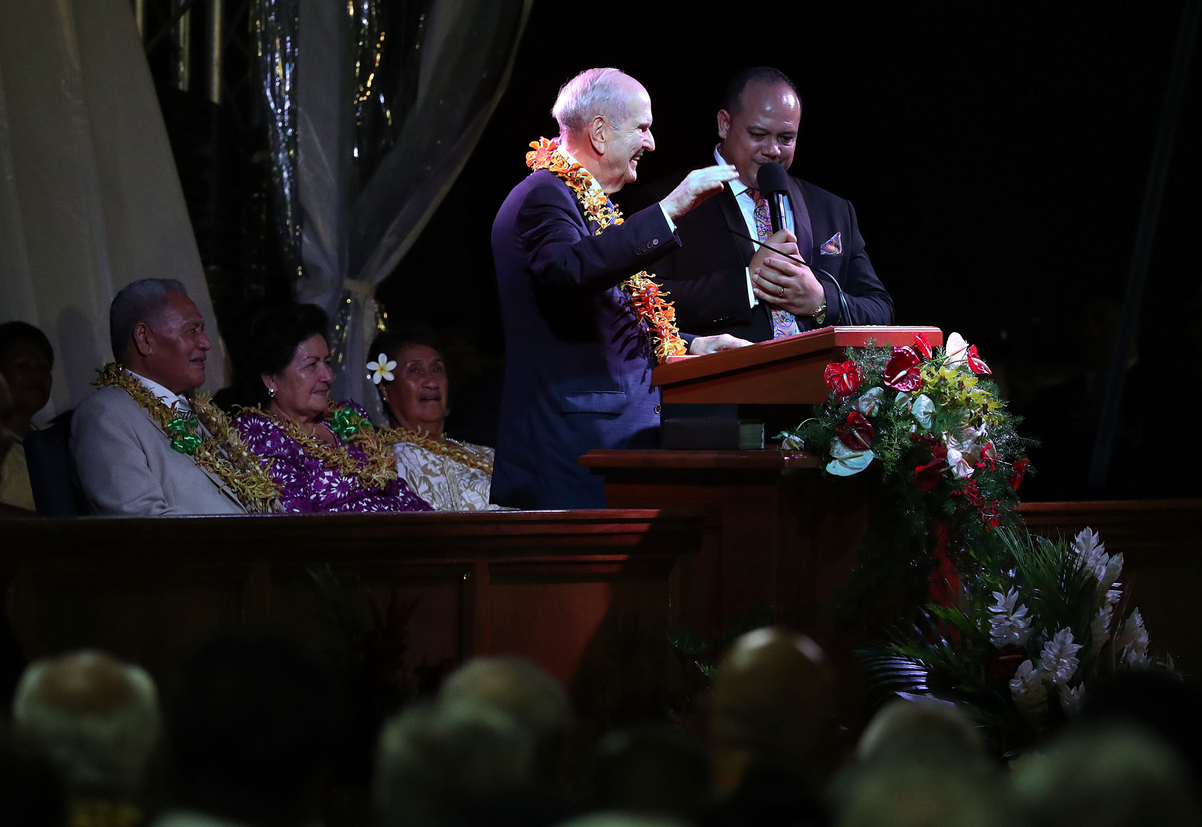 President Russell M. Nelson of The Church of Jesus Christ of Latter-day Saints speaks during a devotional in Apia, Samoa, on Saturday, May 18, 2019. At right is interpreter Jason Joseph.