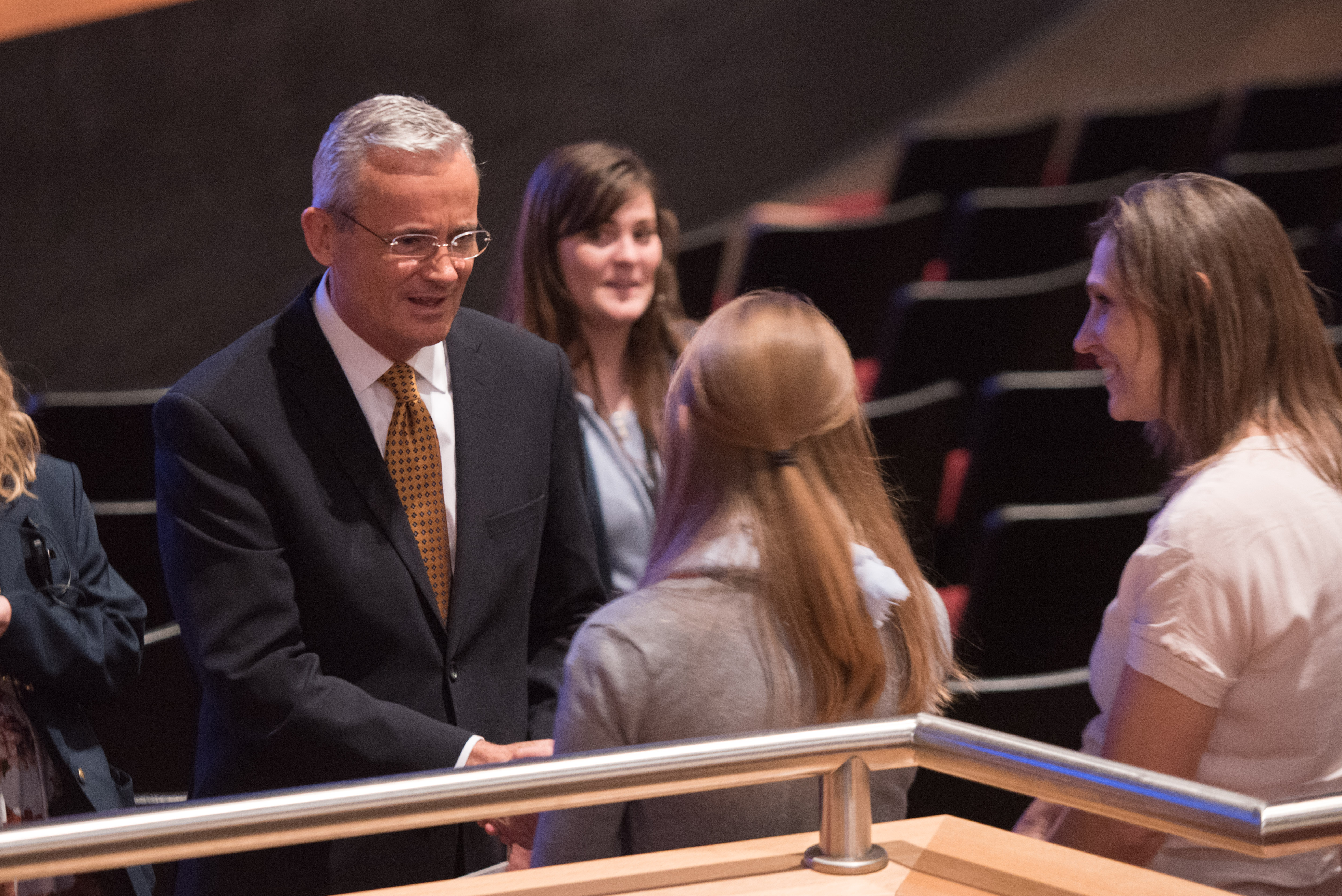 Elder Patrick Kearon of the Presidency of the Seventy greets devotional attendees following the Worldwide Devotional for Young Adults held in the BYU-Idaho Center in Rexburg, Idaho, on May 6, 2018.