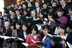 Missionary choir performs at a meeting presided over and addressed by Elder Dallin H. Oaks during his visit to Japan.