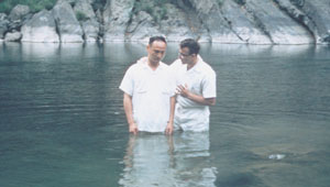 Tseng I-Chang, left, with Elder Weldon Kitchen, was first missionary-taught person to be baptized in beautiful Taiwan.