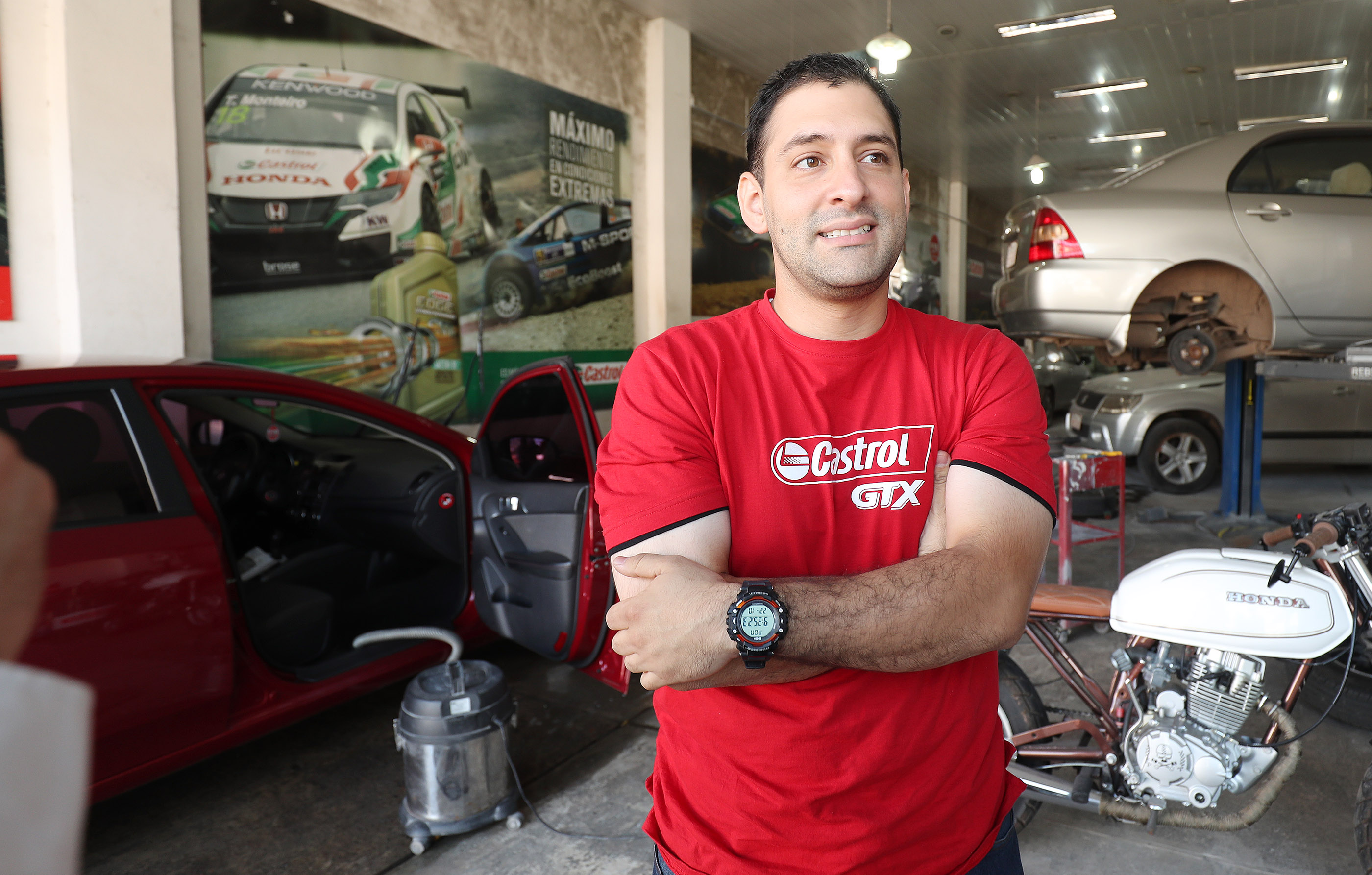 Bishop Lorenzo Britez talks about his car wash and auto body store in Asuncion, Paraguay, on Monday, Oct. 22, 2018. Bishop Britez took Self Reliance courses offered by the Church to help with his business skills.