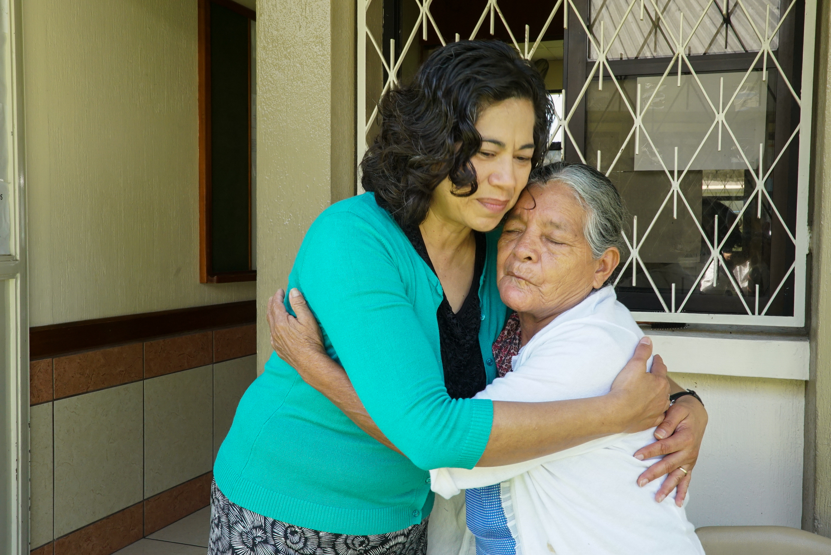Sister Reyna I. Aburto, second counselor in the Relief Society general presidency, gives a hug to a Church member who is living in temporary housing following a volcano eruption in Guatemala, Wednesday, August 29, 2018.