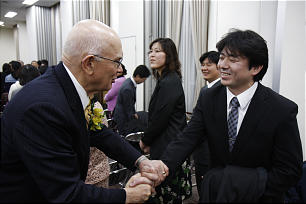 Elder Dallin H. Oaks of the of the Quorum of the Twelve greets Oonuma Satoru, president of the Ishinomaki Branch, who, in the days after the disaster, strengthened members and delivered needed supplies to them.