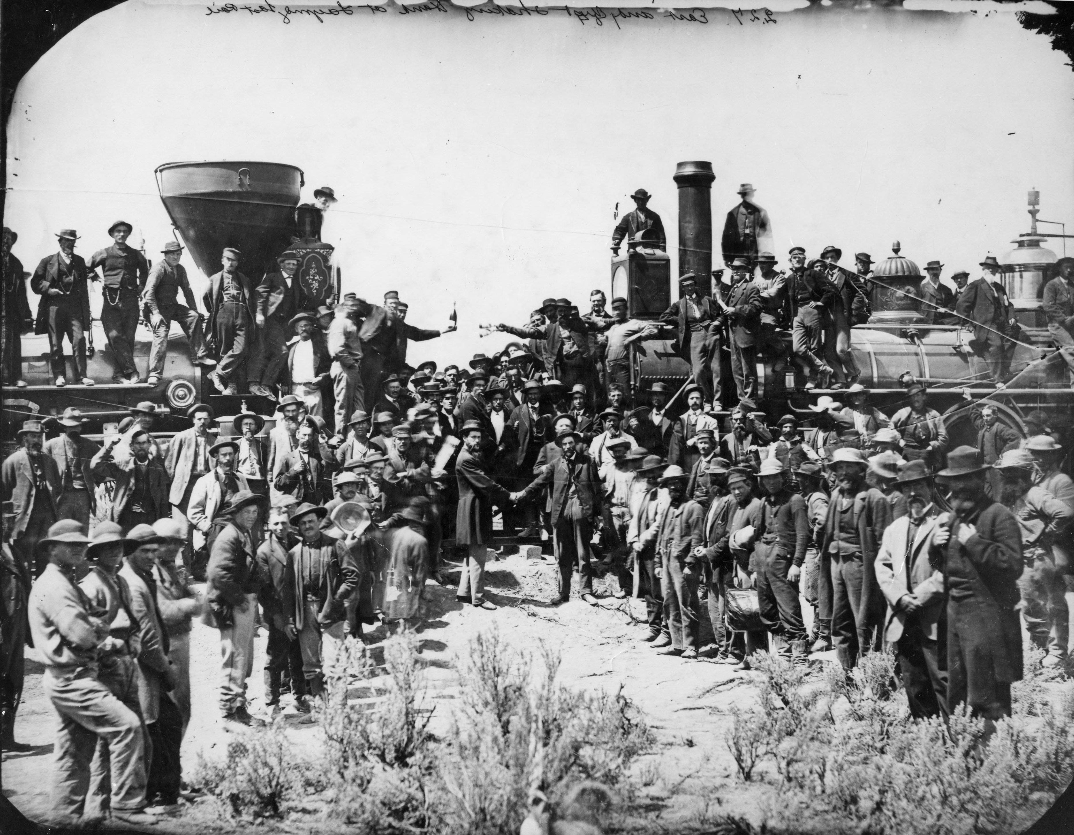 The joining of the rails at Promontory, Utah, is photographed May 10, 1869. The photo is taken from the original glass plate from the Oakland Museum.
