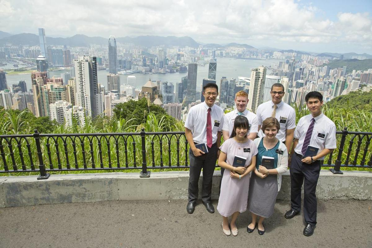 Missionaries serving in the China Hong Kong Mission. The photo was taken from Victoria Peak, showing Hong Kong in the background. Back row from left: Elder Kho, Elder Mikesell, Elder Little, Elder Tong; in front: Sister Law and Sister Garlitz.