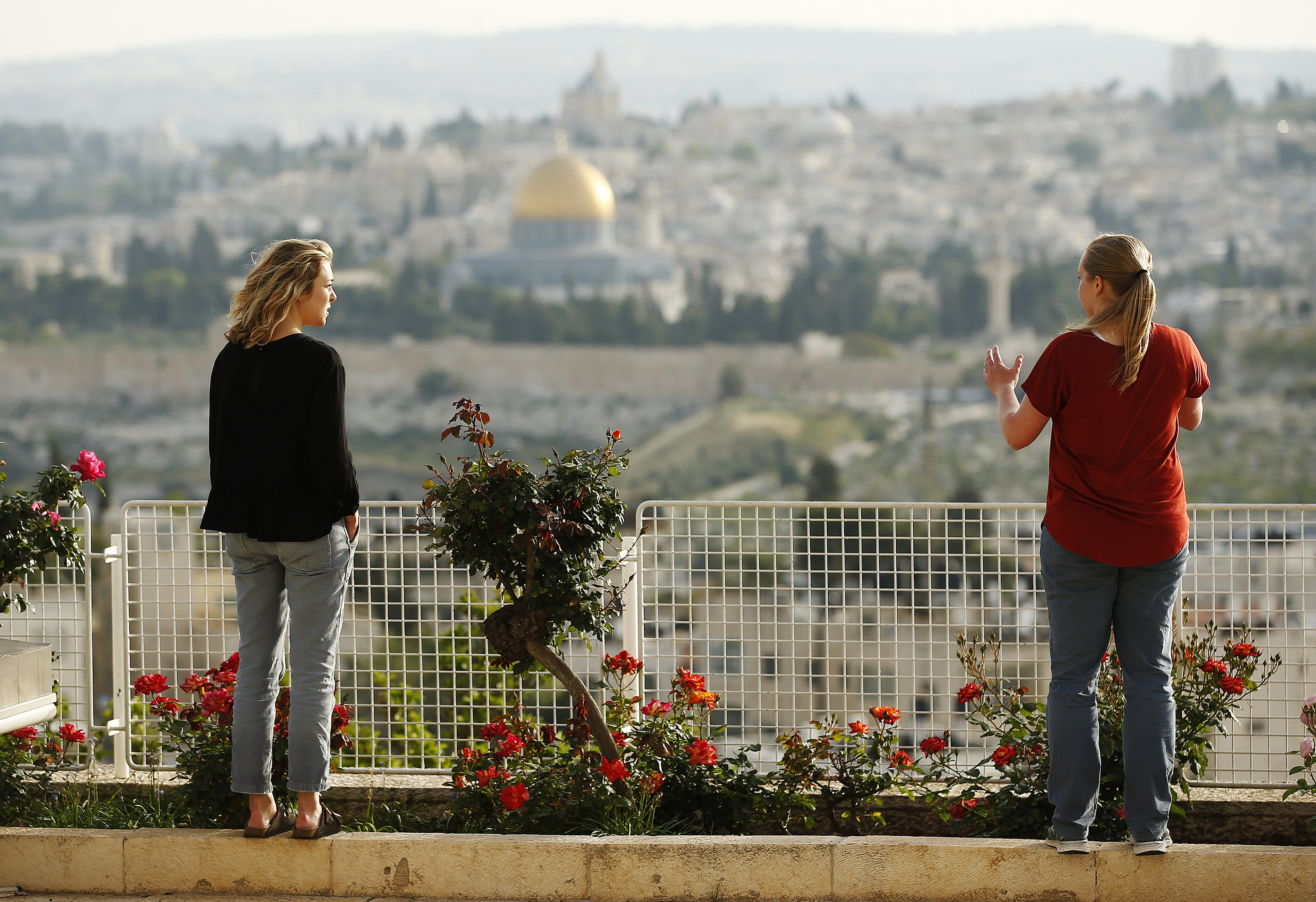 Cassidy Heaton and Chelsea Neubert, students at the BYU Jerusalem Center, look over the view of the Old City in Jerusalem on Friday, April 13, 2018.