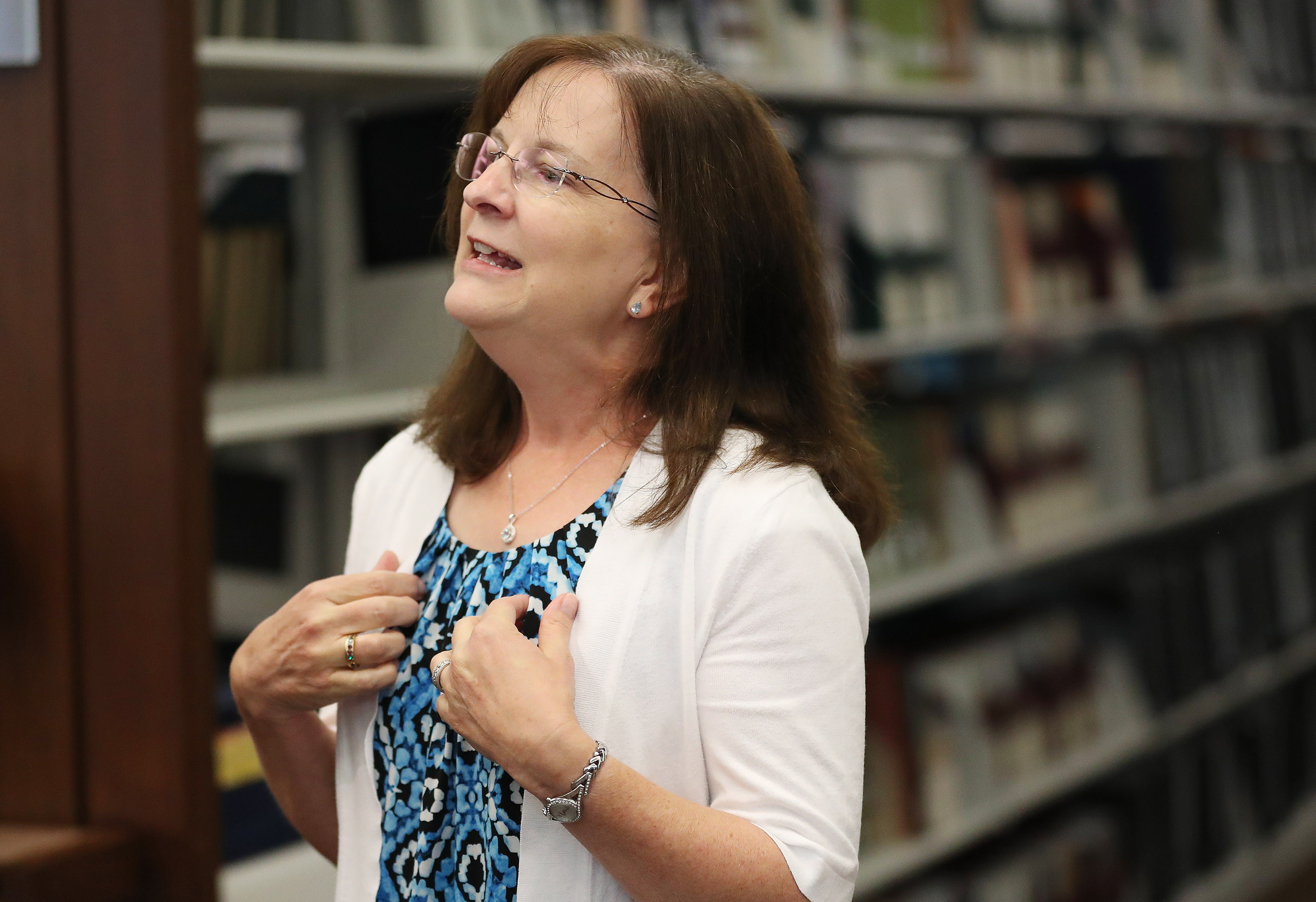 """Writer Lisa Olsen Tait speaks during a press conference announcing the """"Saints: The Story of the Church of Jesus Christ in the Latter Days"""" book in Salt Lake City on Tuesday, Sept. 4, 2018."""