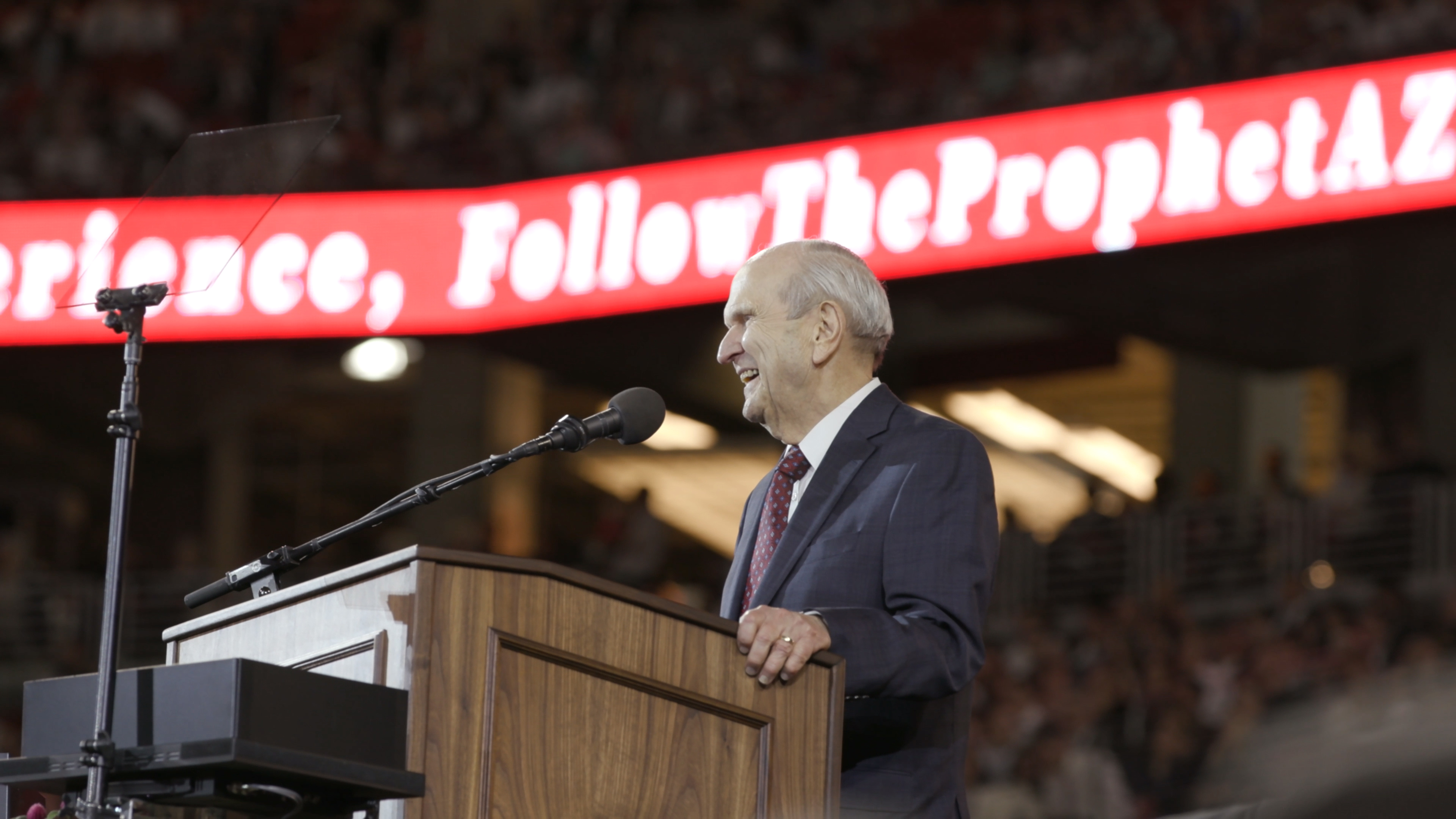 President Russell M. Nelson speaks during a devotional at the State Farm Stadium in Glendale, Arizona.