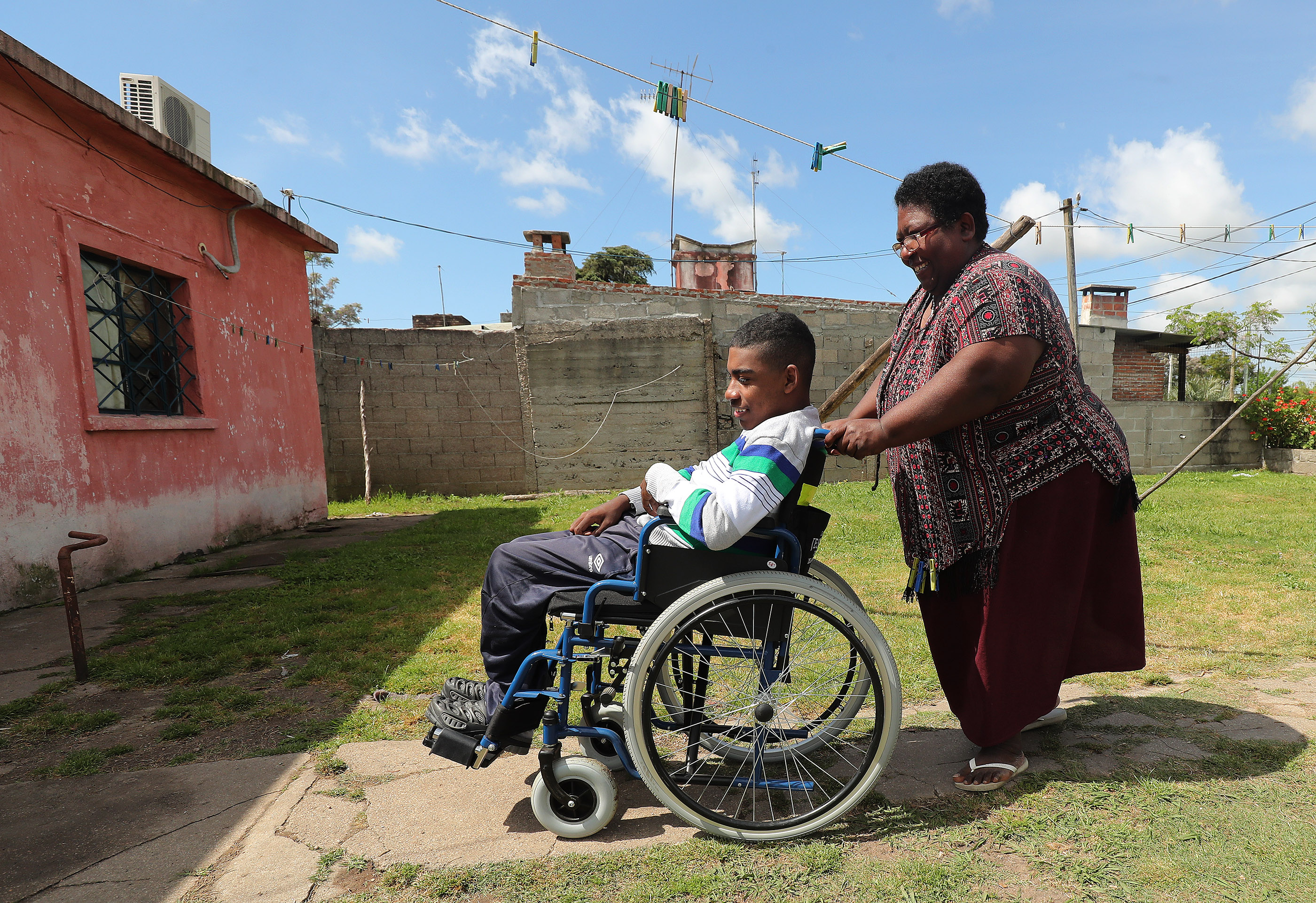 Alejandro Bravo is wheeled by his mother, Sandra Bravo, at their home in Toledo, Uruguay, on Thursday, Oct. 25, 2018. Bravo was born premature and had other medical complications and received a wheelchair from LDS Charities.