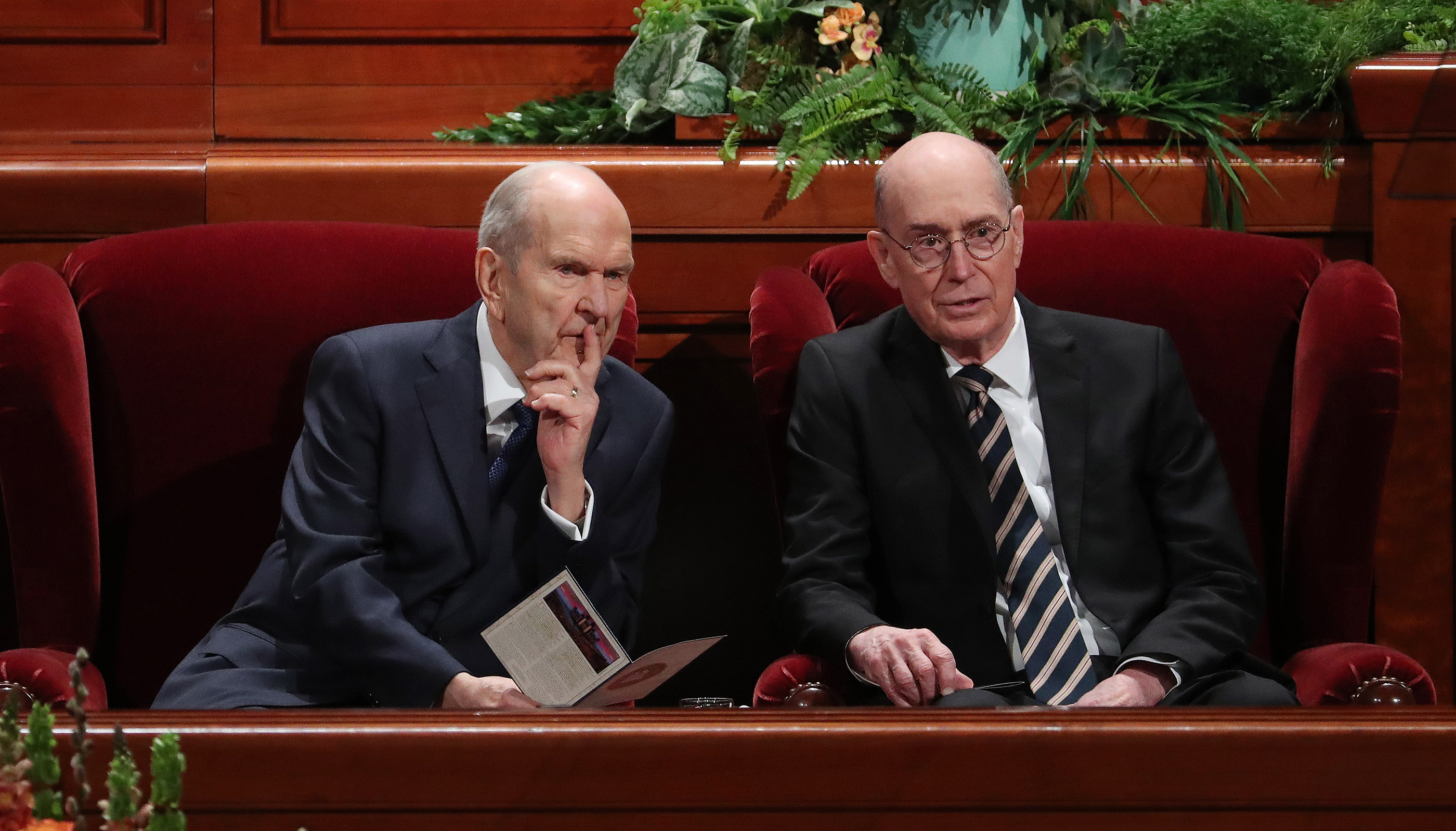 President Russell M. Nelson, center, and President Henry B. Eyring talk prior to the 189th Annual General Conference of The Church of Jesus Christ of Latter-day Saints in Salt Lake City on Sunday, April 7, 2019.