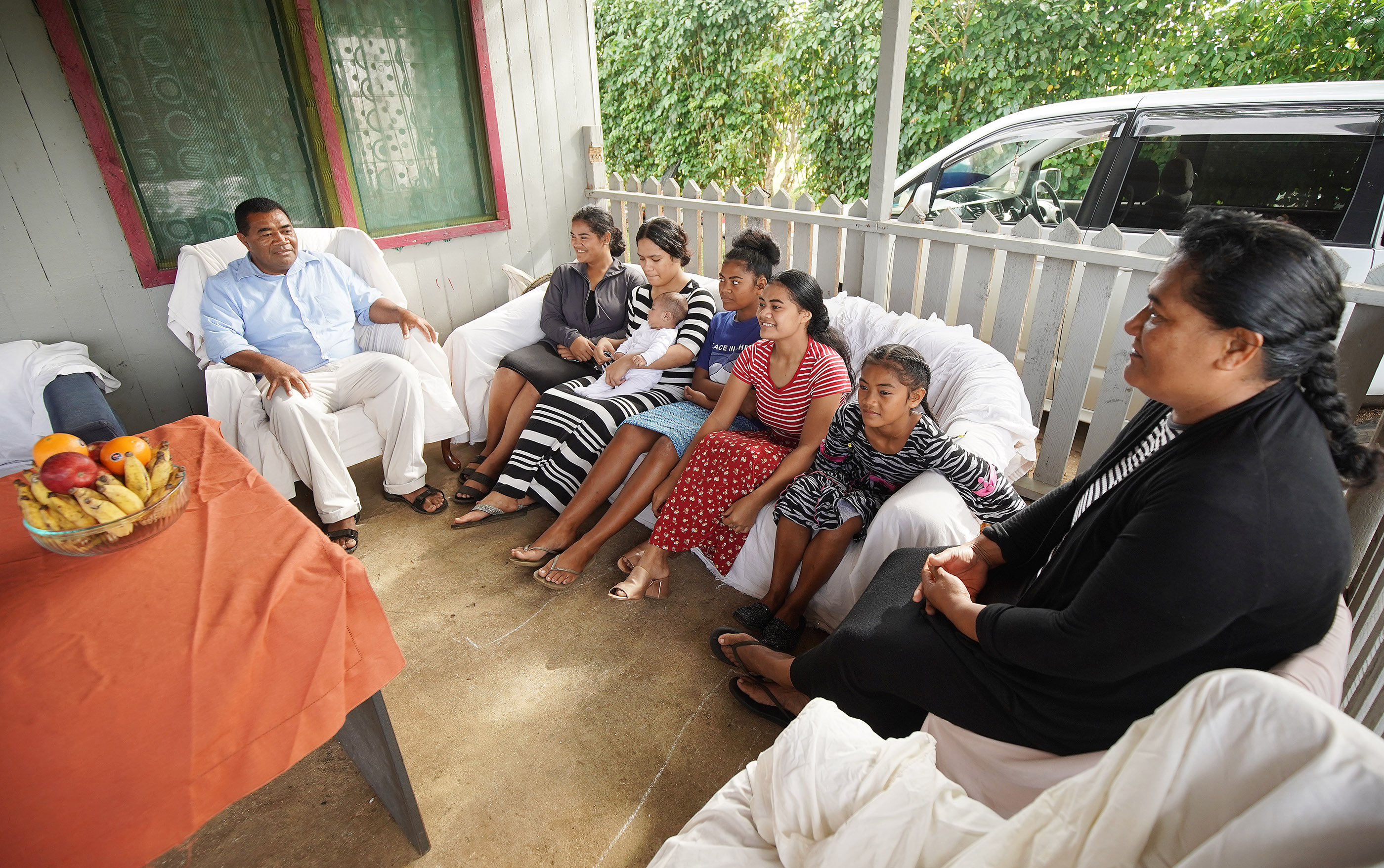 Tohiminiti Latu talks with some of his children at their his home in Tonga on May 23, 2019. Latu is bishop of his ward and has 10 children and one grandchild.