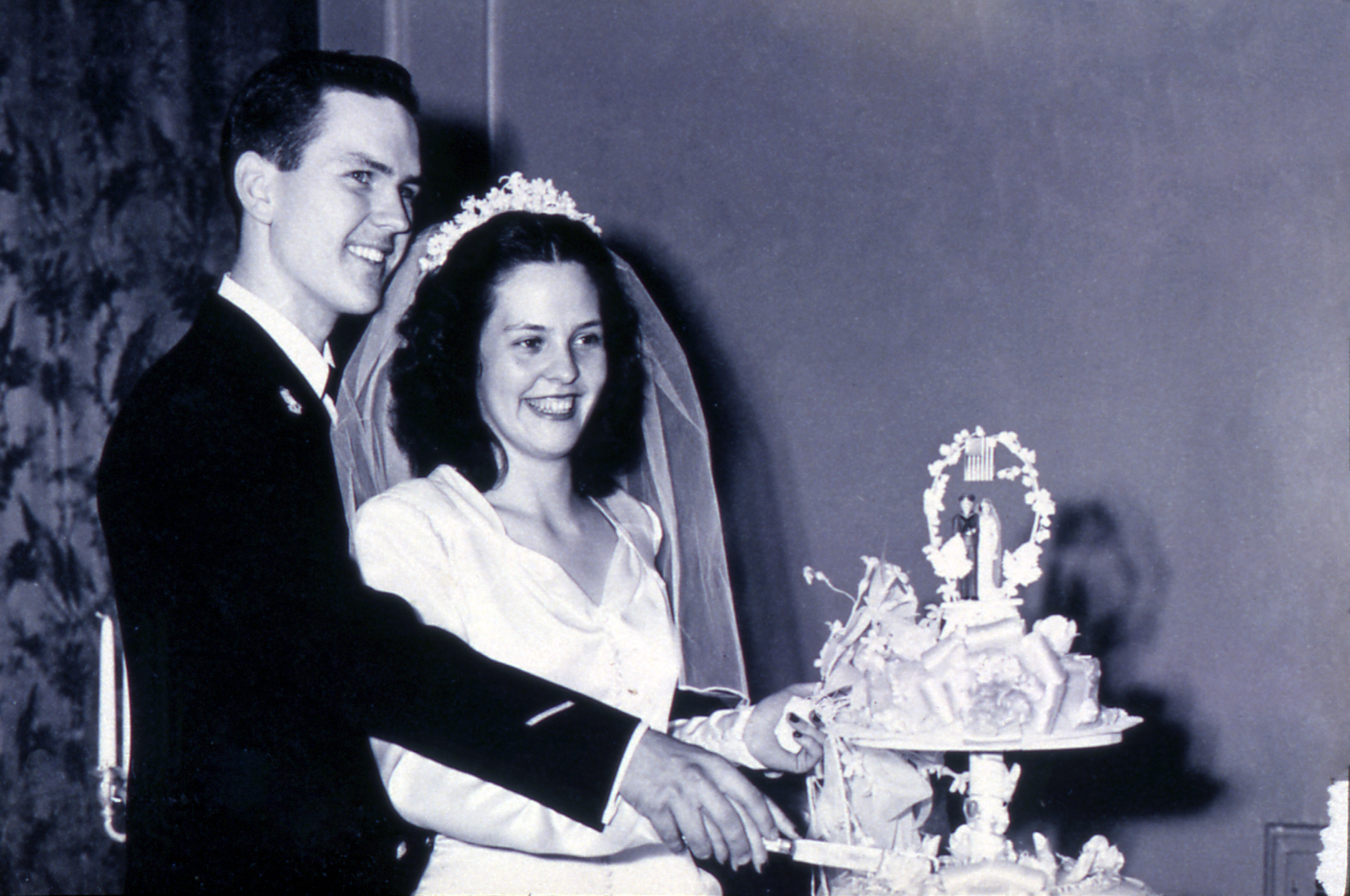 Russell and Dantzel Nelson cut their wedding cake on Aug. 31, 1945.