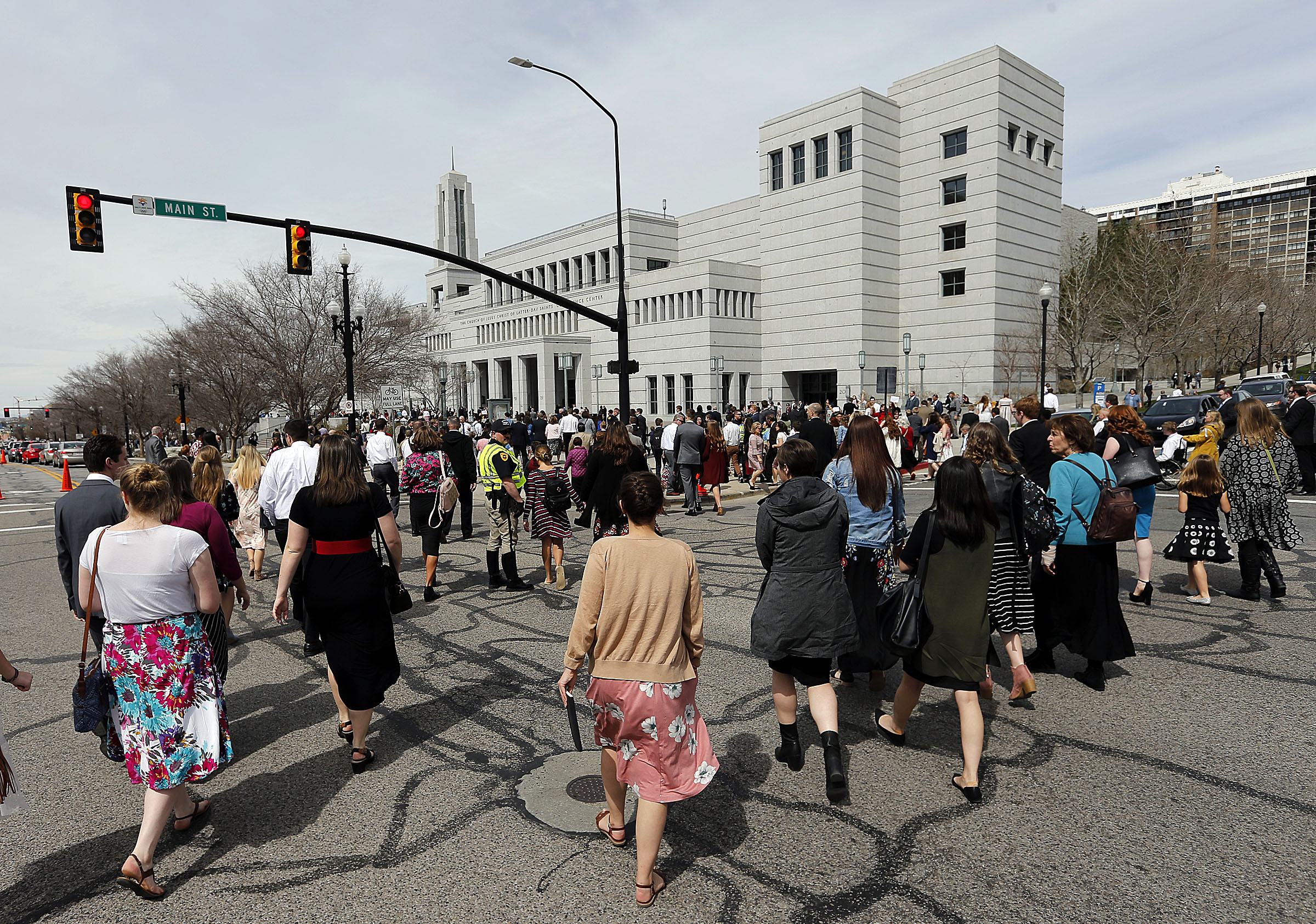 Conferencegoers walk to the Conference Center for the Saturday afternoon session of the LDS Church's 188th Annual General Conference in Salt Lake City on Saturday, March 31, 2018.