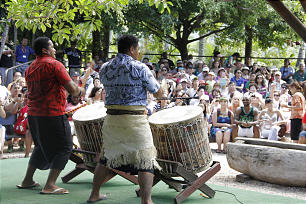 Performers at Polynesian Cultural Center do a drum presentation for visitors.