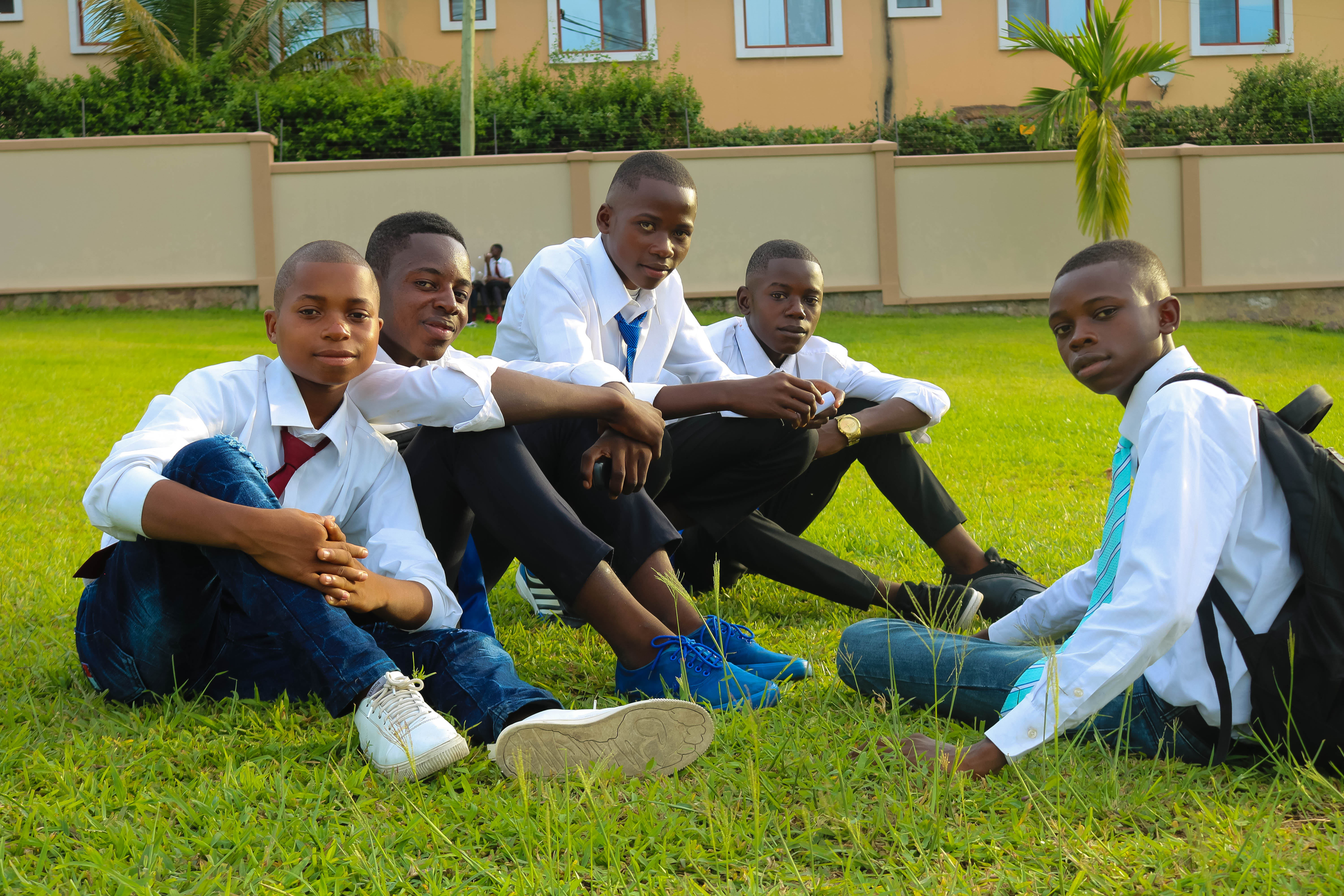 Young men sit on the Kinshasa Democratic Republic of the Congo Temple grounds Saturday prior to an afternoon youth devotional with Elder Dale G. Renlund of the Quorum of the Twelve Apostles on Saturday, April 13, 2019, a day before the dedication of the temple there.