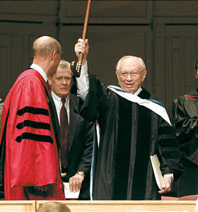President Gordon B. Hinckley greets graduates while Elder Henry B. Eyring of Quorum of the Twelve stands by.
