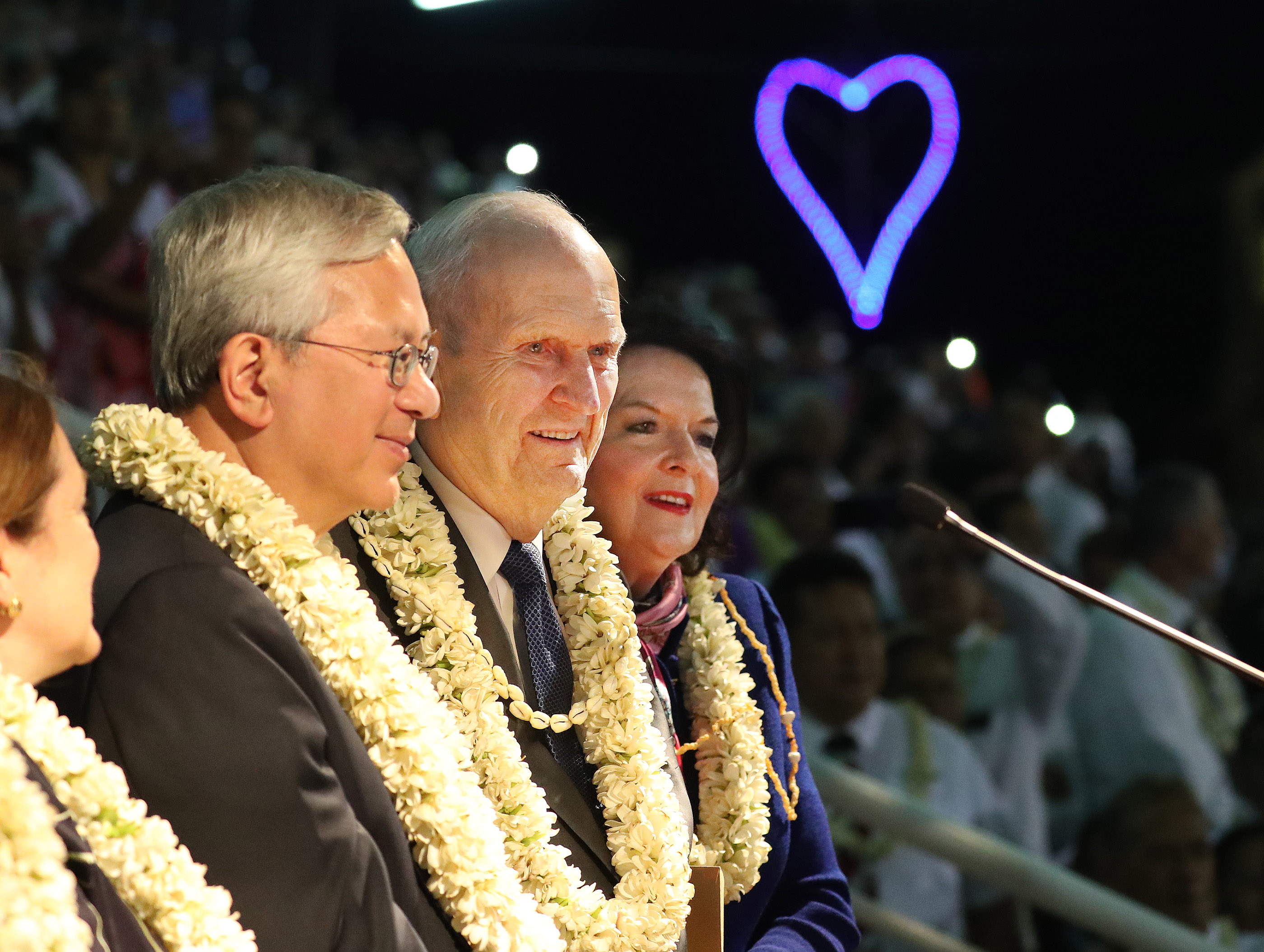 President Russell M. Nelson of The Church of Jesus Christ of Latter-day Saints and his wife, Sister Wendy Nelson, and Elder Gerrit W. Gong of the Quorum of the Twelve Apostles listen to attendees sing for them after a devotional in Papeete, Tahiti, on May 24, 2019.