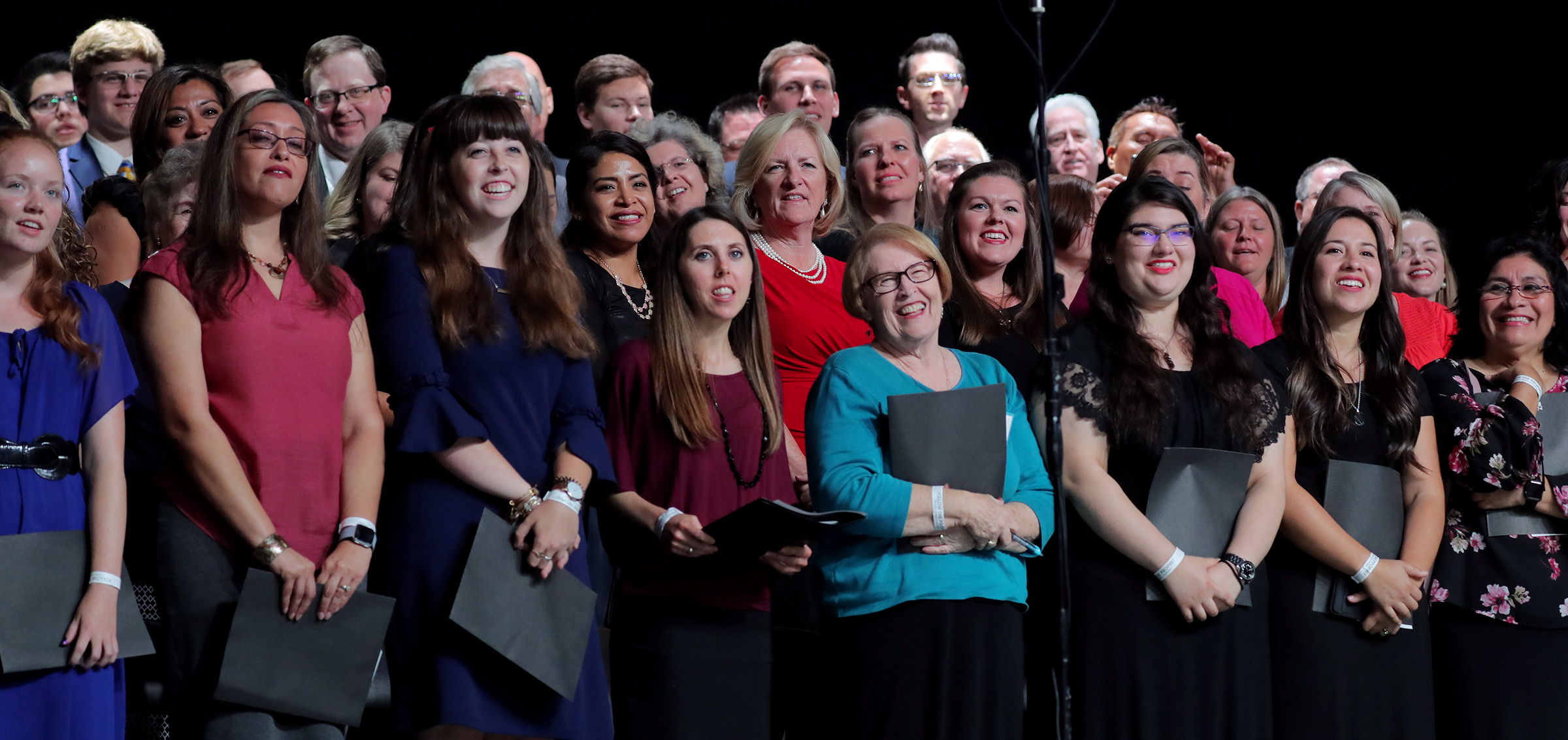Choir members smile at President Russell M. Nelson and his wife, Sister Wendy Nelson, at the conclusion of the devotional at the Amway Center in Orlando, Florida, on Sunday, June 9, 2019.