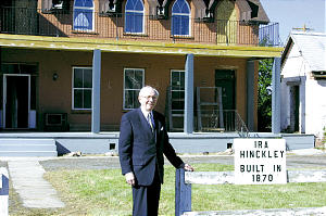 President Gordon B. Hinckley poses near Fillmore home once owned by his grandfather.
