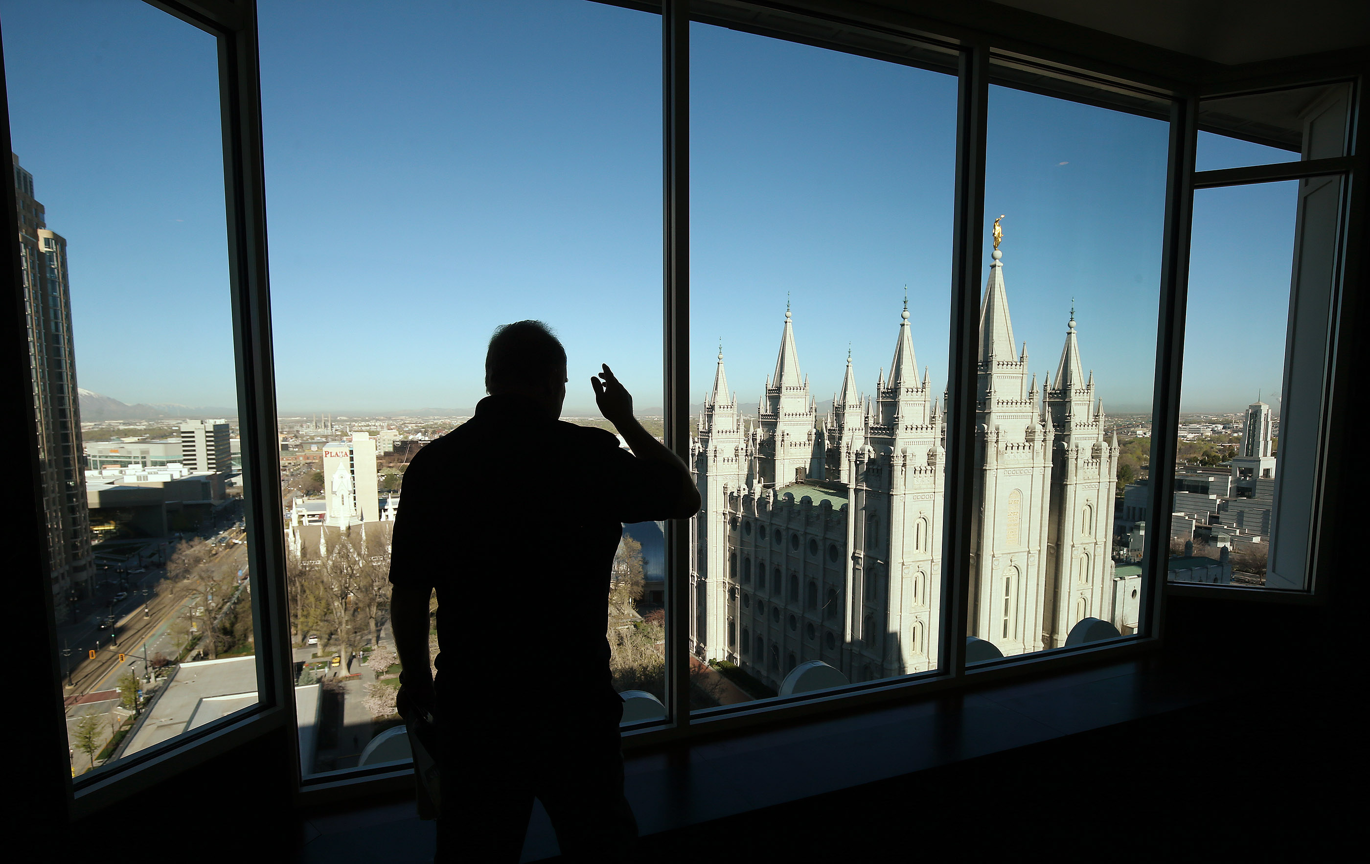 A person looks over the grounds of the Salt Lake Temple in Salt Lake City on Friday, April 19, 2019. Leadership of The Church of Jesus Christ of Latter-day Saints announced renovations to the Salt Lake Temple and changes to the temple grounds and Temple Square.