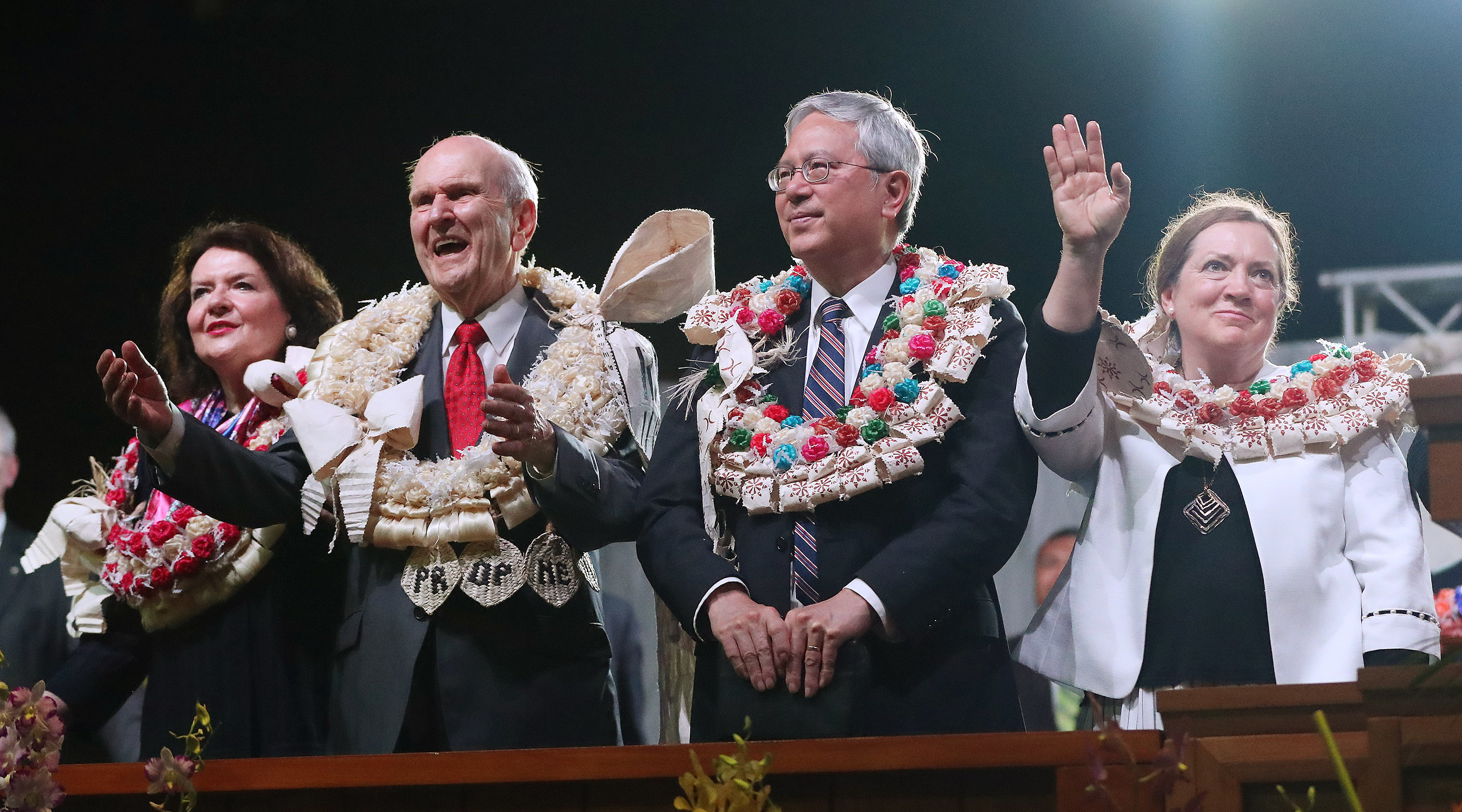 President Russell M. Nelson of The Church of Jesus Christ of Latter-day Saints and his wife Sister Wendy Nelson and Elder Elder Gerrit W. Gong, of The Church of Jesus Christ of Latter-day Saints' Quorum of the Twelve Apostles and bis wife Sister Susan Gong wave goodbye to attendees after a devotional in Nausori, Fiji on May 22, 2019.