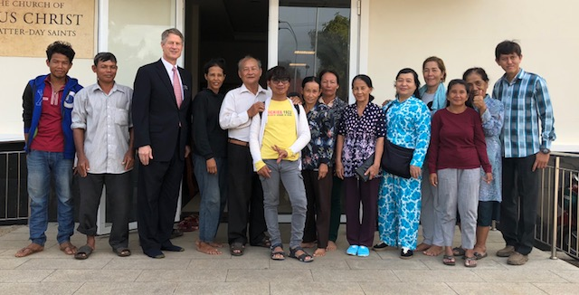 Missionaries and members outside their chapel in Kampong Cham, Cambodia.