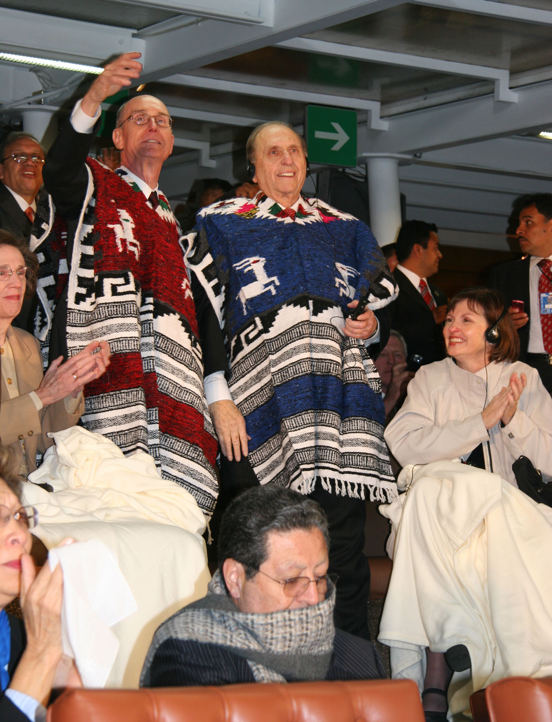 The image shows President Thomas S. Monson and President Henry B. Eyring saluting the 87,000 people inside Mexico City's Aztec stadium during the LDS Mexican cultural event. Monson and Eyring are wearing Mexican serapes to stay warm. Jason N. Swensen/Deseret News