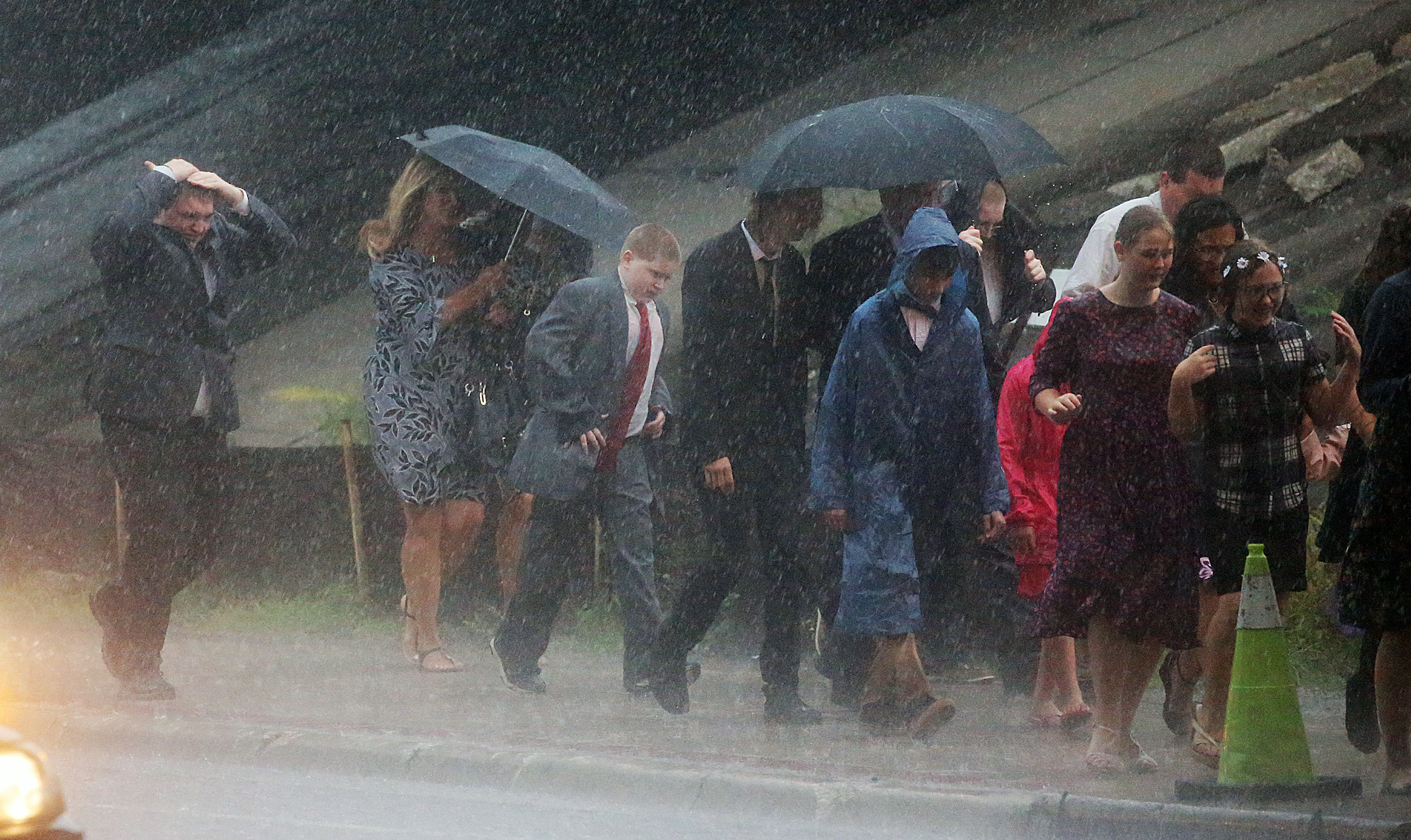 Devotional attendees brave the rain as they make their way to the Amway Center to listen to President Russell M. Nelson and other Church leaders speak in Orlando, Florida, on Sunday, June 9, 2019.