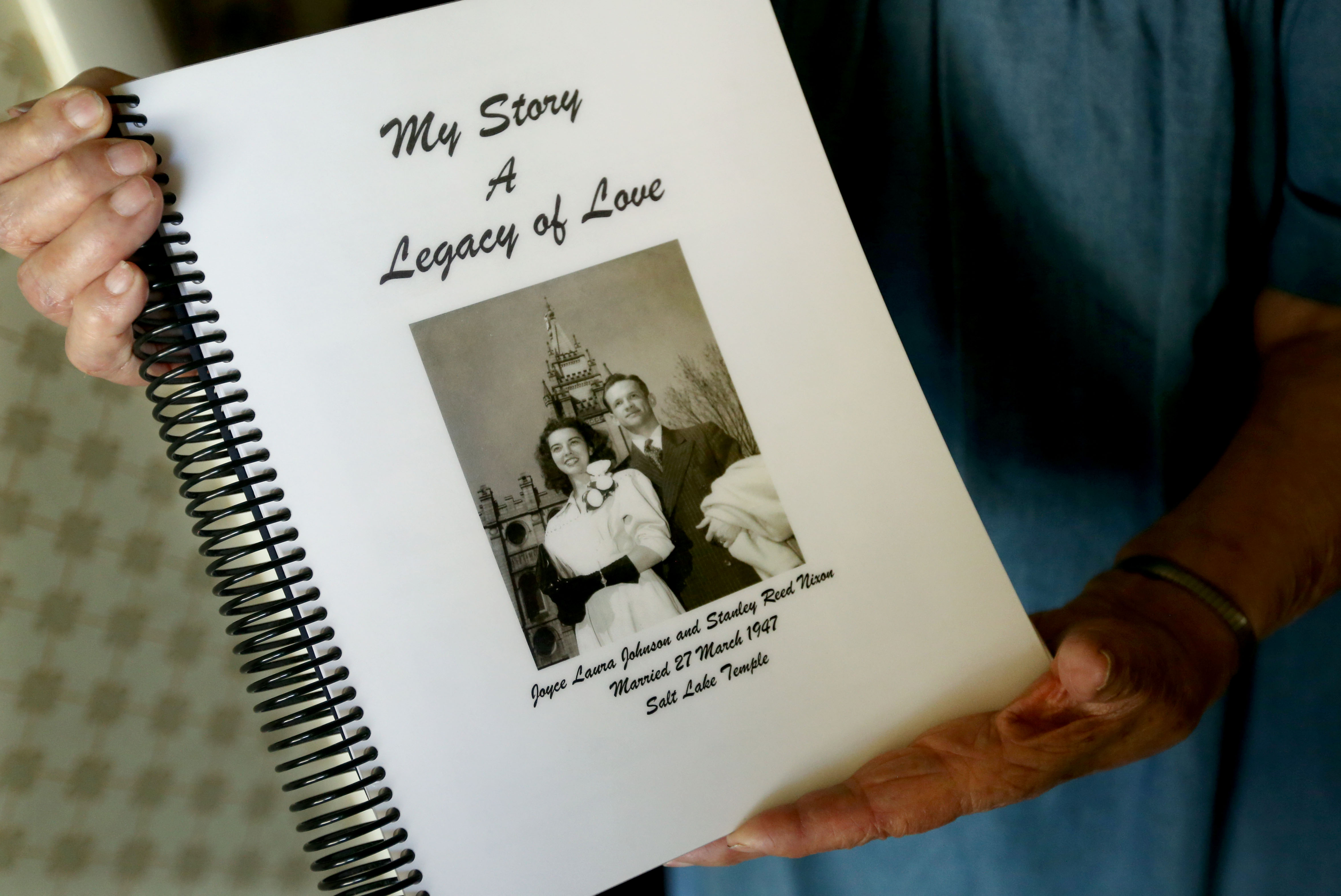 Joyce Nixon holds her autobiography in her Orem home on Wednesday, July 10, 2019.