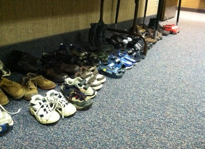 An area at the ward house full of shoes donated to help others.