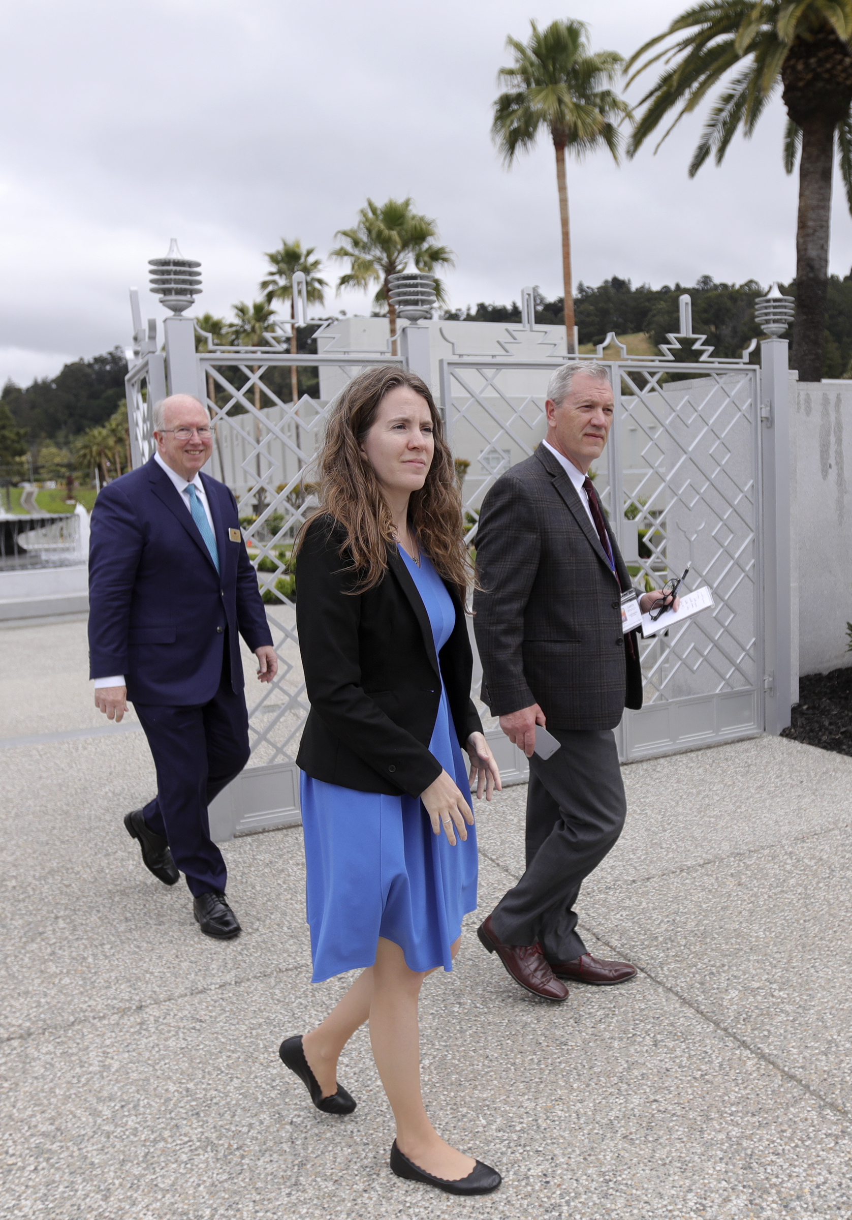 Emily Utt, center, historic sites curator for The Church of Jesus Christ of Latter-day Saints, approaches the newly renovated Oakland California Temple, of The Church of Jesus Christ of Latter-day Saints, for a tour in Oakland, Calif., on Monday, May 6, 2019.
