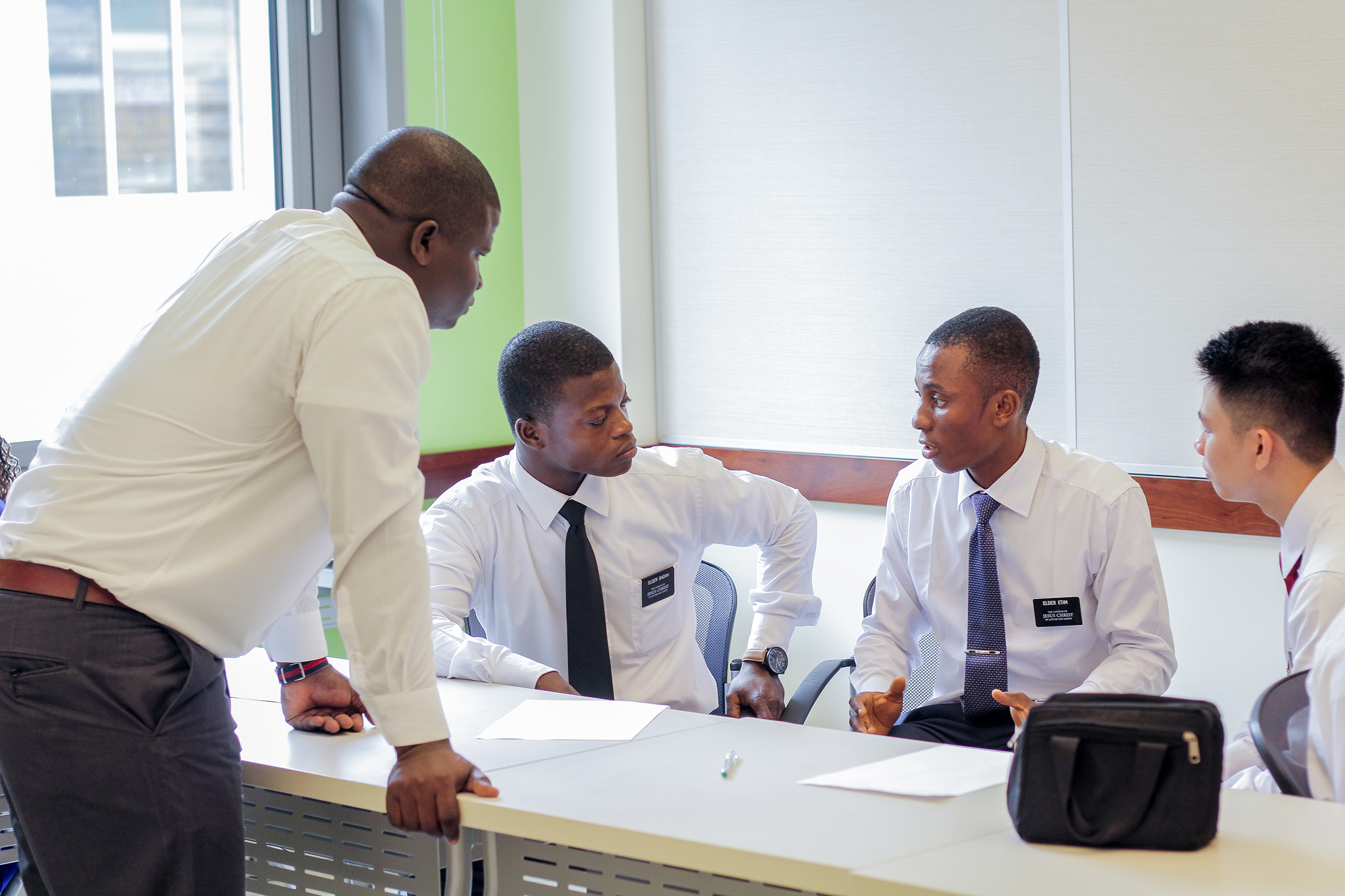 Missionary converse in a classroom of the Ghana Missionary Training Center in 2017.