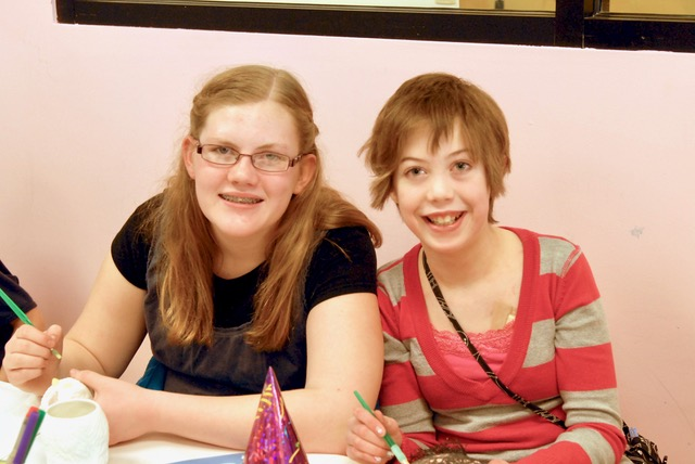 Years before her death, Katy Doak, right, attends a party with her friend, Elizabeth Weaver.