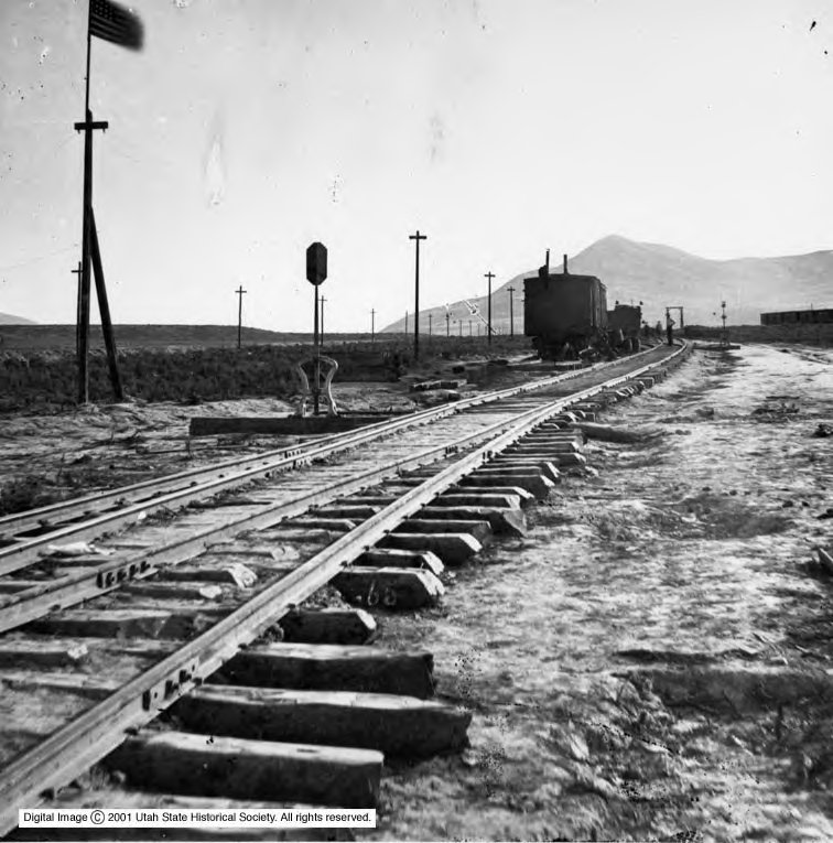 This image was captured by William H. Jackson two months after the driving of the last spike in 1869. Note the U.S. flag with 30 stars.