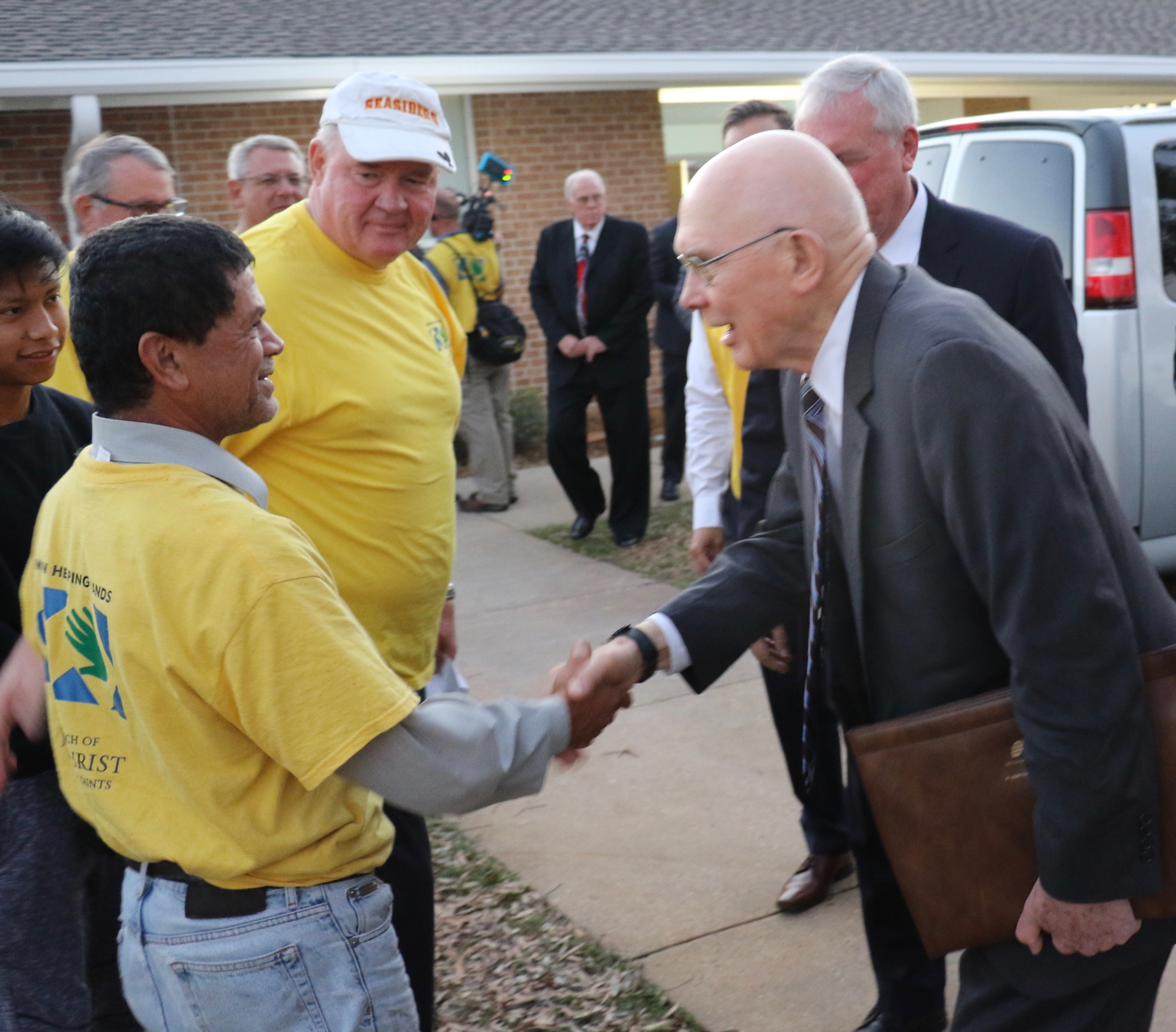 President Dallin H. Oaks, first counselor in the First Presidency of The Church of Jesus Christ of Latter-day Saints, greets a Helping Hands worker Oct. 21, 2018 at the Panama City Florida Stake Center.