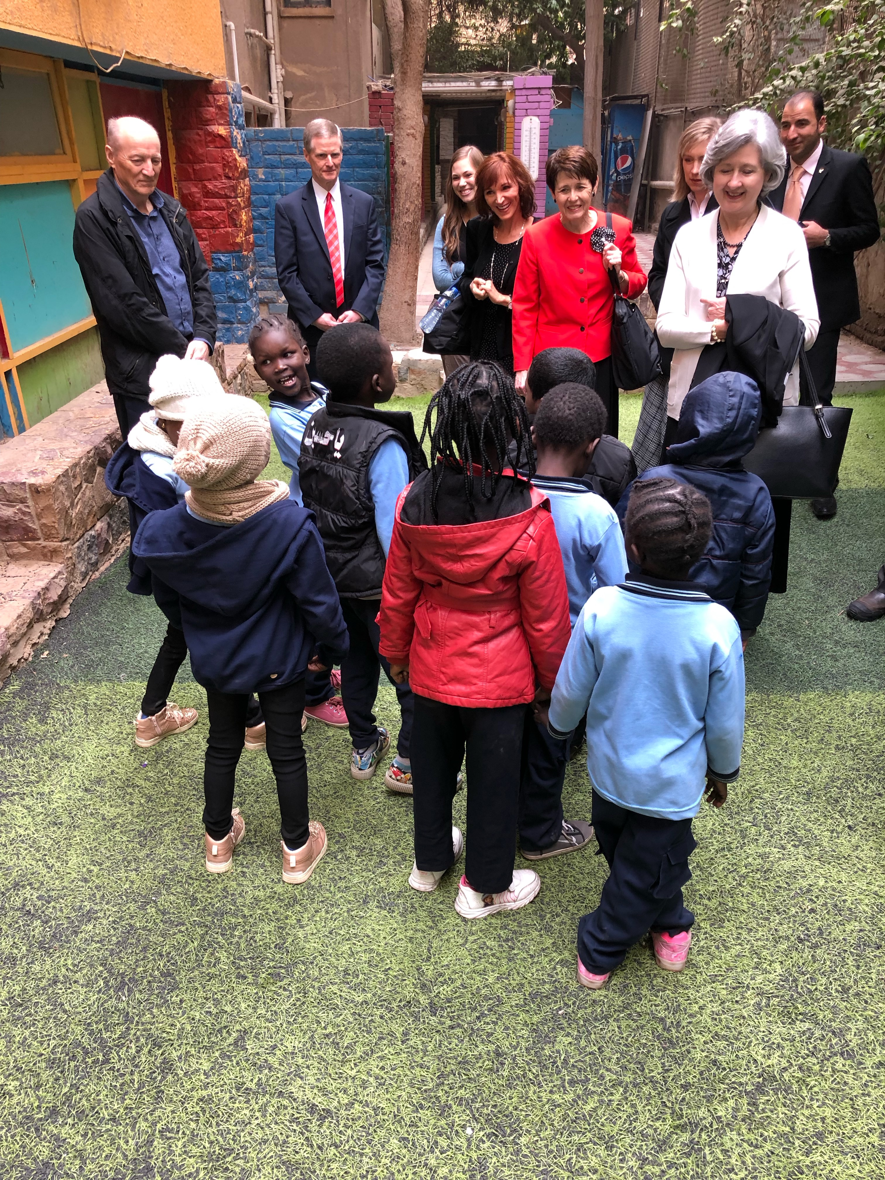Children from the African Hope Learning Centre in Cairo, Egypt, gather to greet Elder David A. Bednar, second from left, Sister Susan Bednar fourth from right, and others guests on Wednesday, Jan. 23, 2019.