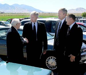 Following Grantsville Utah Stake conference, President Gordon B. Hinckley, left bids goodbye to Brook P. Hales, stake president, and A. Jim Keetch and Chad W. Allred, counselors.