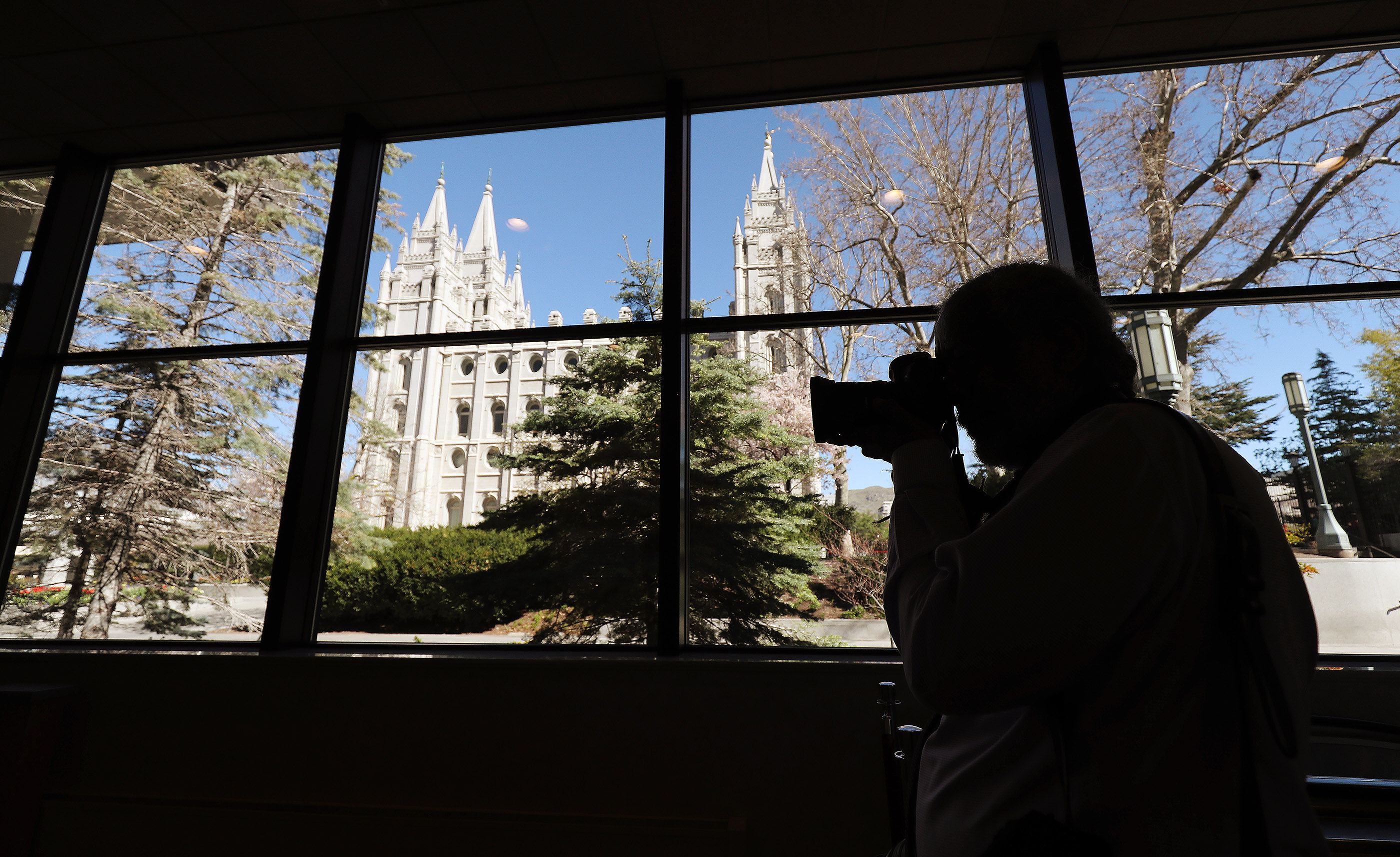 A photographer shoots a photo in the South Visitors' Center on Temple Square in Salt Lake City on Friday, April 19, 2019. Leadership of The Church of Jesus Christ of Latter-day Saints announced renovation plans for the Salt Lake Temple and changes to the temple grounds and Temple Square, including the visitors center.