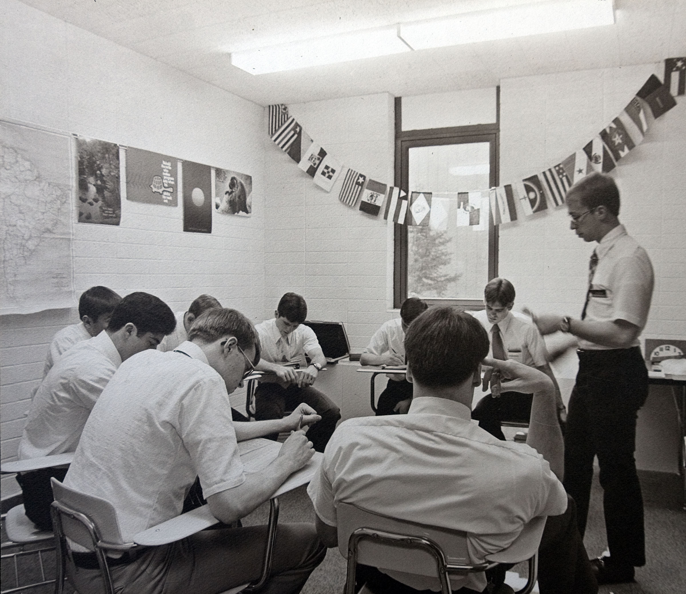 """""""Missionaries spend many classroom hours each day learning foreign language and missionary discussions, practicing teaching skills, studying scriptures, and developing deeper understanding of gospel doctrines and principles."""" — This is the caption information found on the frame plaque accompany this photo, one nearly dozen historical photos showing the development of the Language Training Mission and Missionary Training Center facilities in Provo since the 1960s."""
